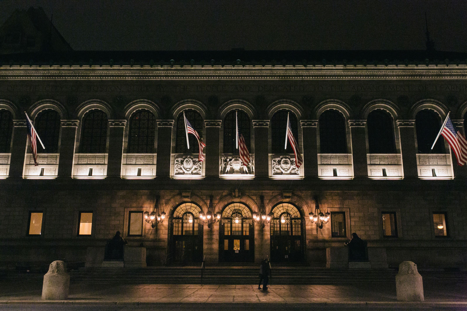 facade of Boston Public Library lit up at night in Boston's Back Bay neighborhood