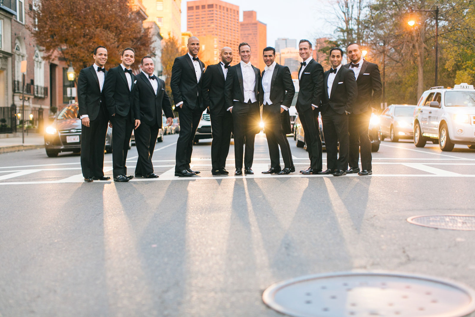 Groomsmen portrait in middle of the street during golden hour in Boston's back bay neighborhood