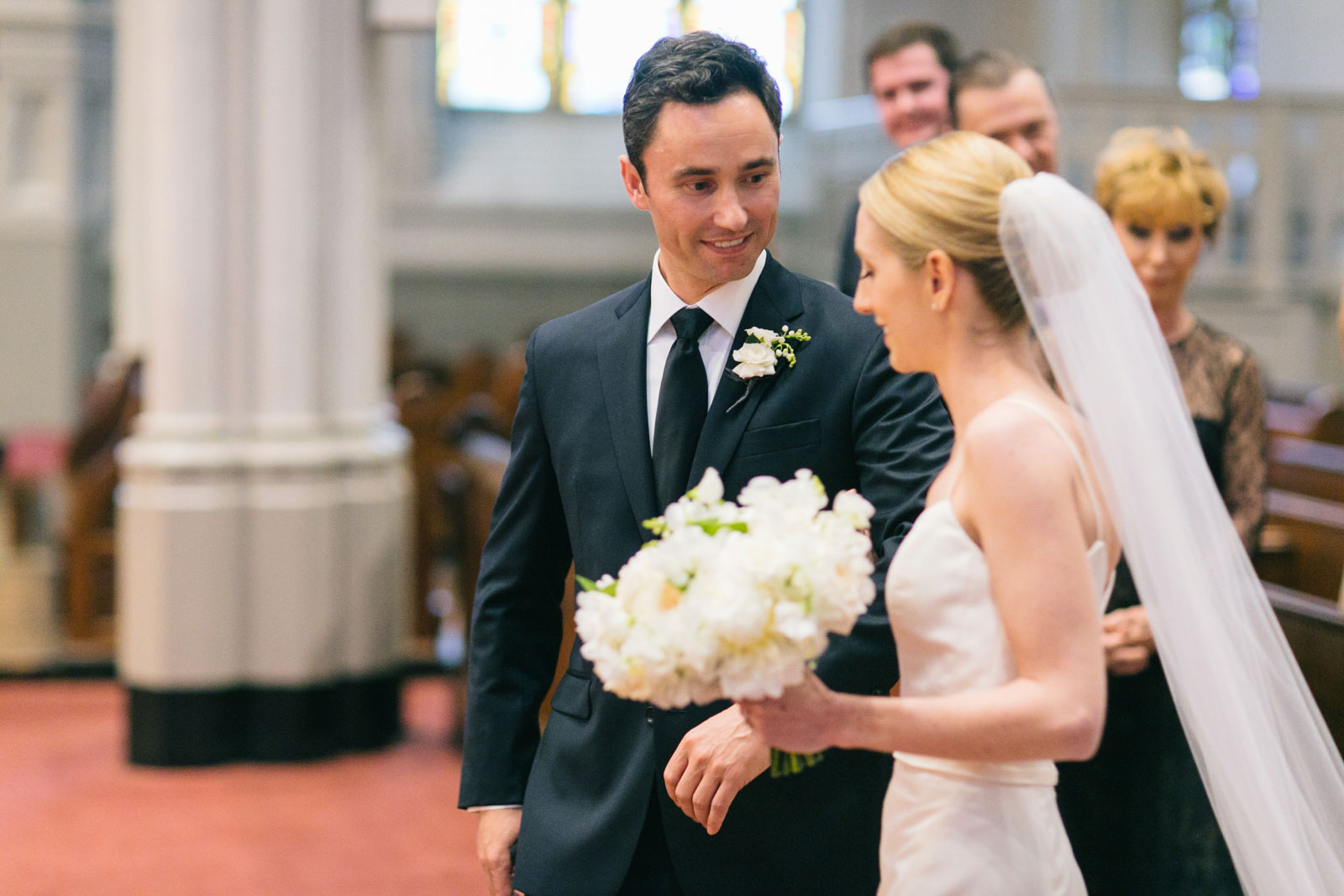 groom gets emotional when seeing bride for the first time during the church wedding ceremony