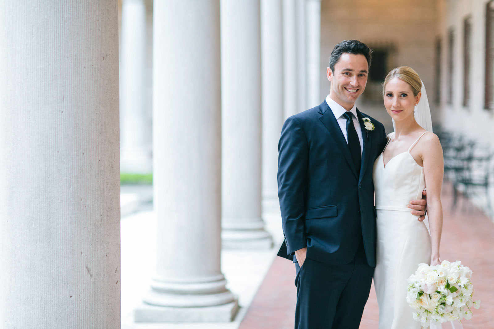 wedding portrait in courtyard of Boston public library with roman pillars and natural light