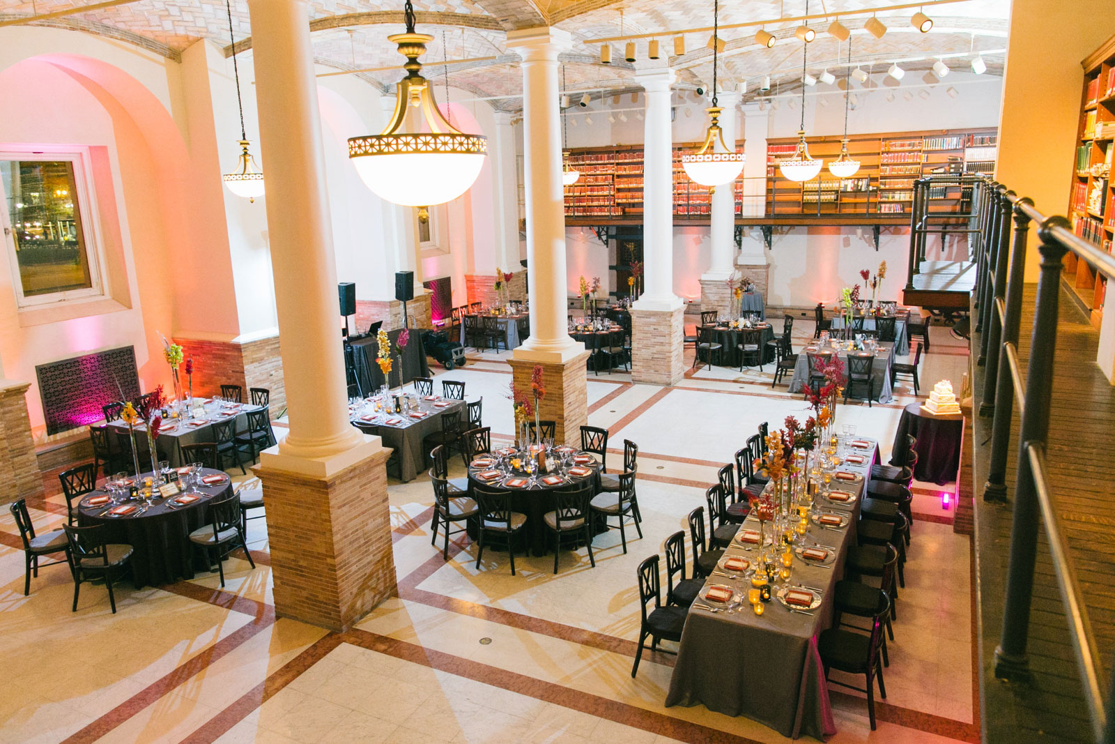 reception space at Boston Public Library with black table cloths and bright colored floral details