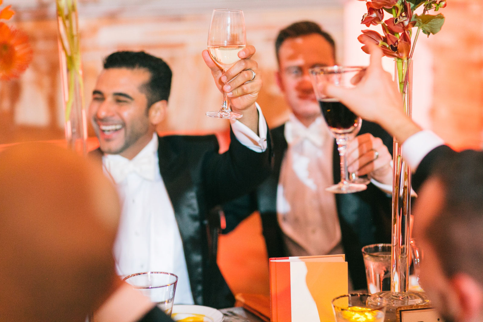 Groom toasting with best man after best man speech at Boston Public Library wedding reception