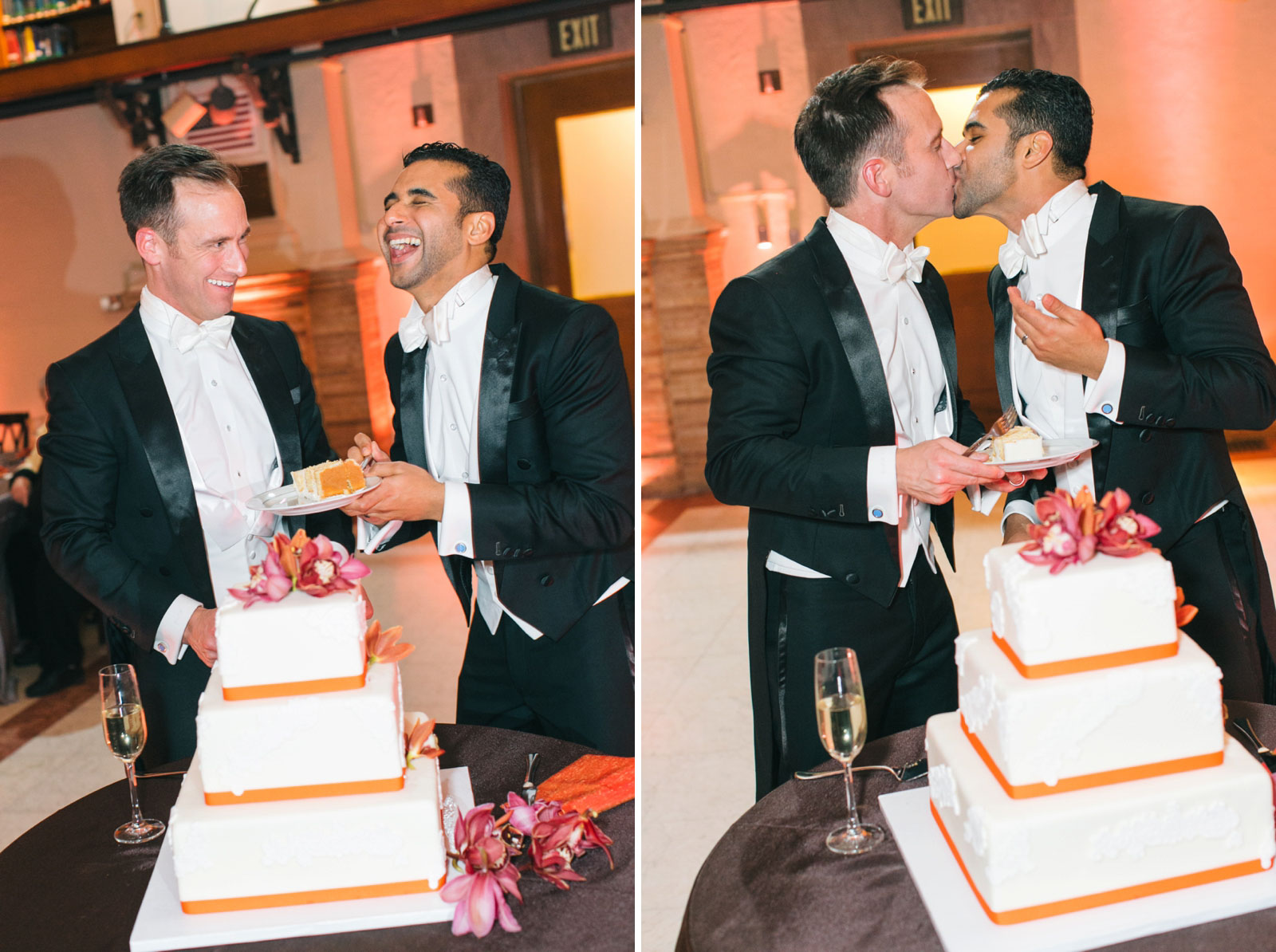 Grooms laughing while cutting cake and kissing in front of cake during same-sex wedding reception.