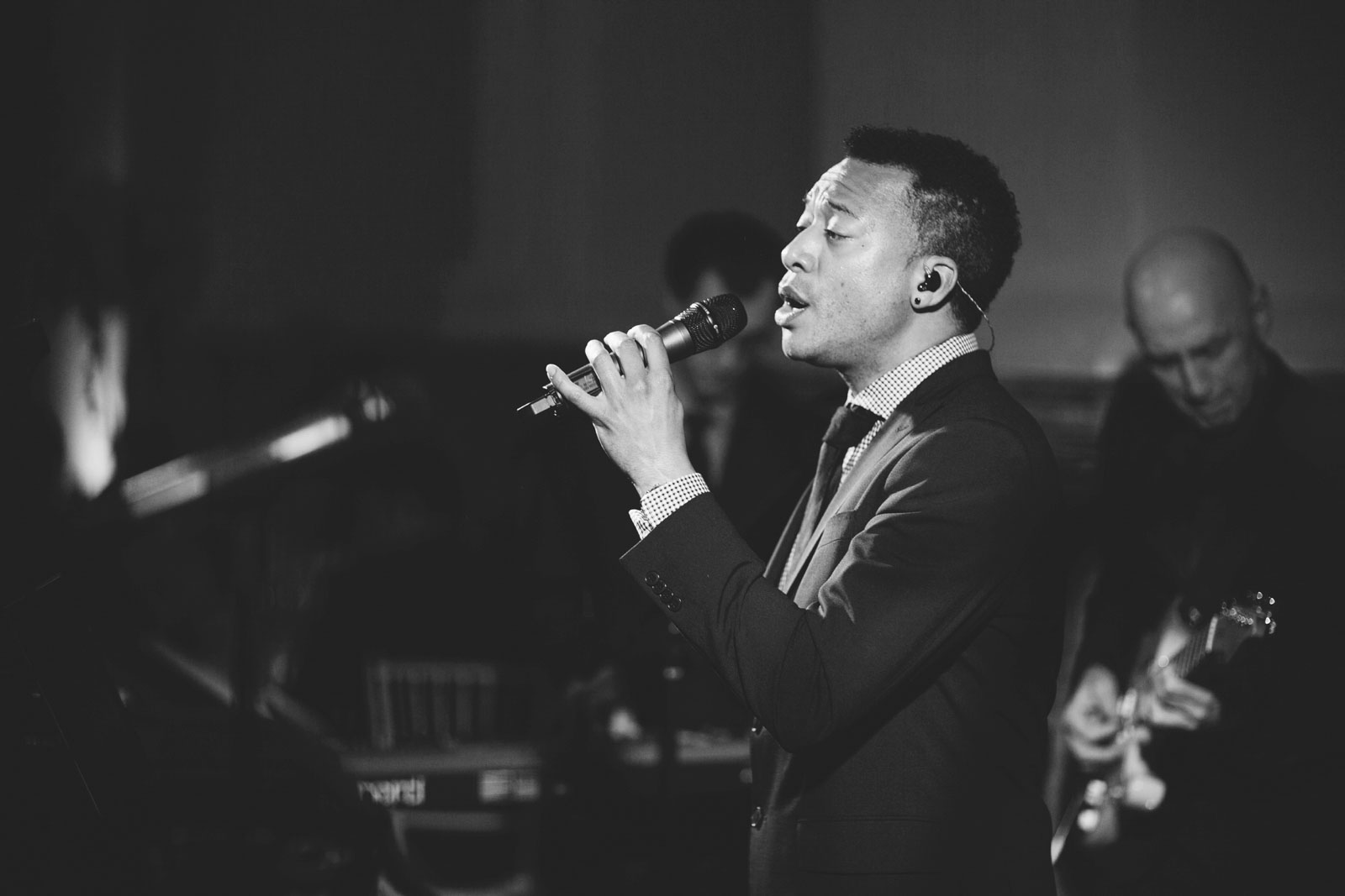 black and white shot of vocalist from live band at wedding reception at Boston Public Library