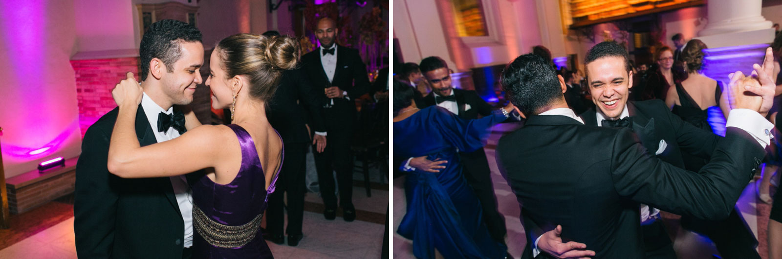Wedding guests dancing during wedding reception with colored up-lighting at Boston public library