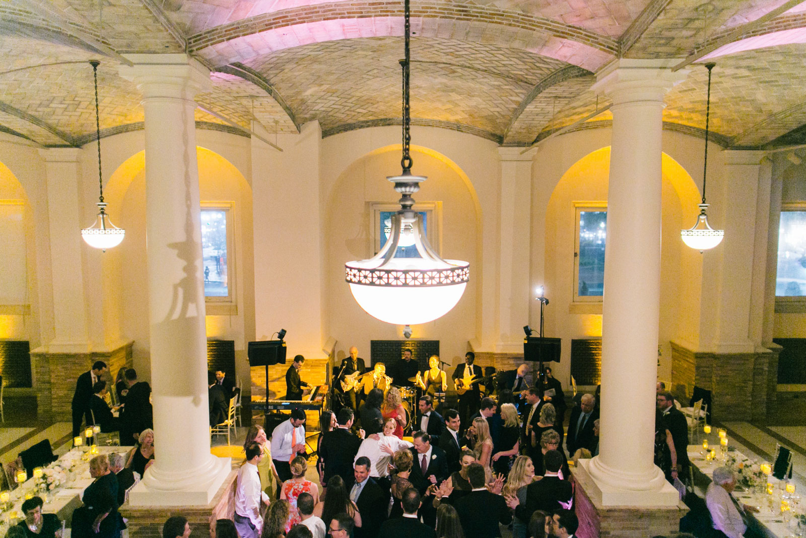wedding guests partying on dance floor at Boston Public Library wedding reception in Guastavino room