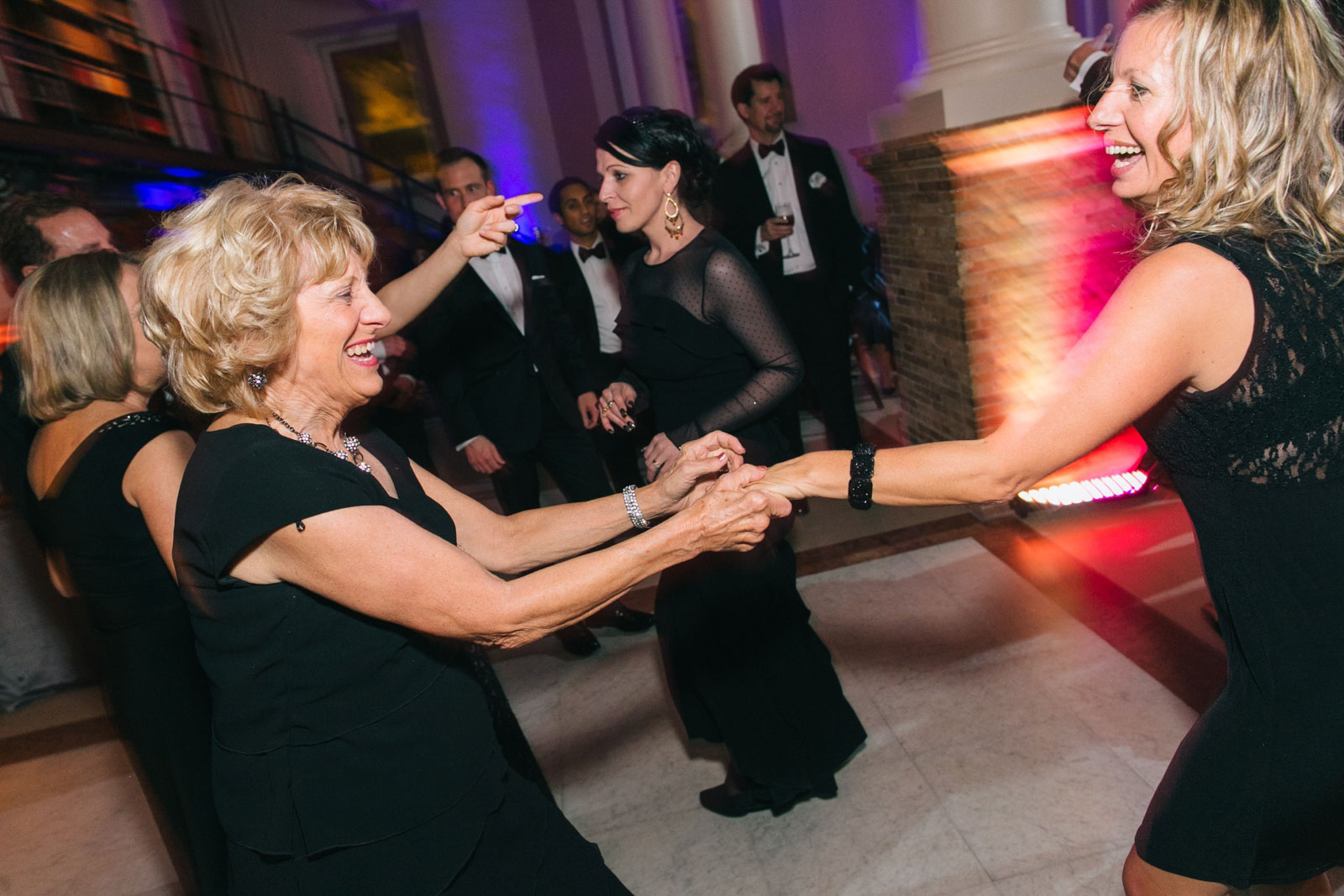 Wedding guests on the dance floor during wedding reception at the Boston Public Library