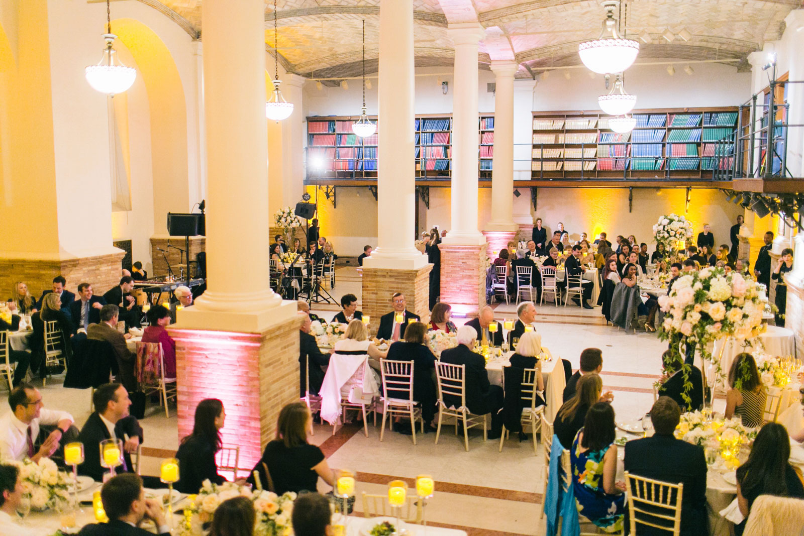 Guests listen to toasts during wedding reception at Guastavino room in Boston public library