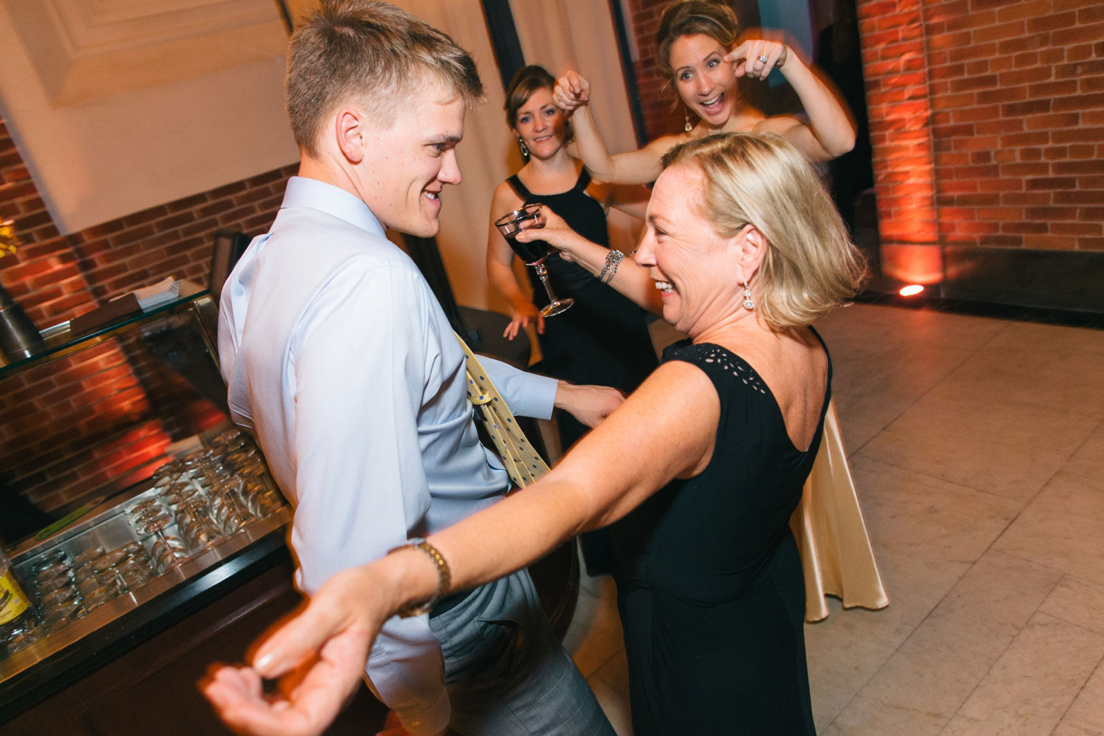 Wedding guests Breaking it down on the dance floor at Boston Public library wedding reception