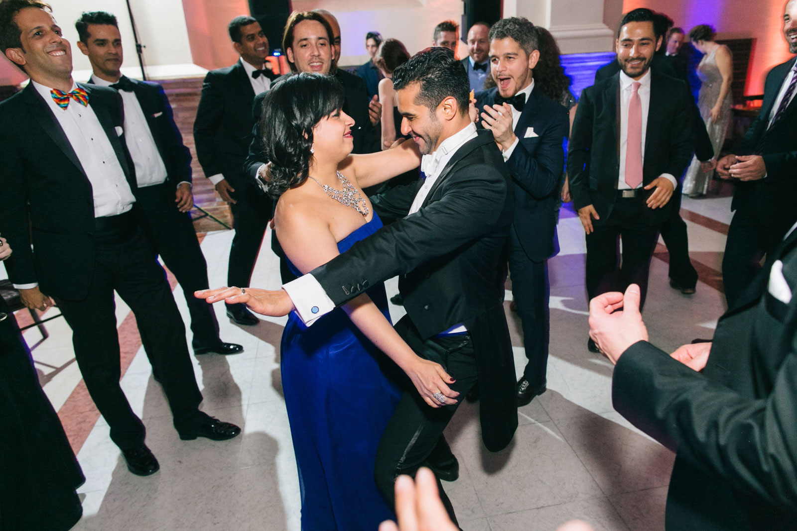 Groom dancing with friends on the dance floor at Boston Public library wedding reception