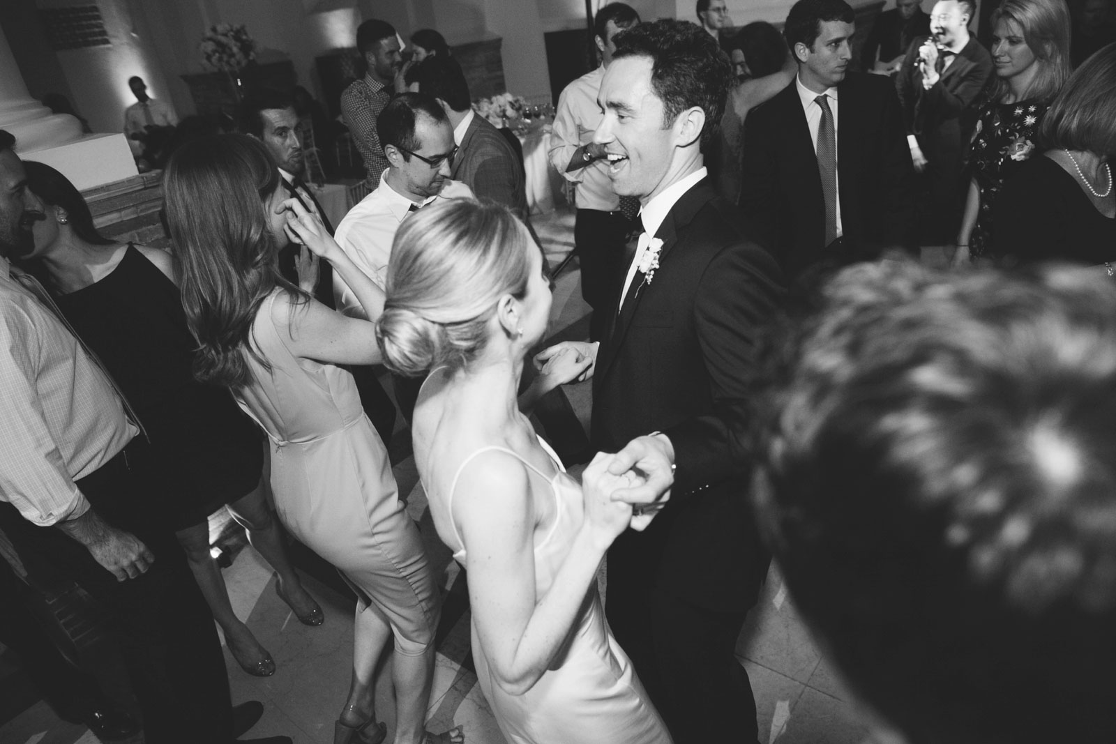 black and white shot of bride and groom dancing on dance floor at their wedding reception at the BPL