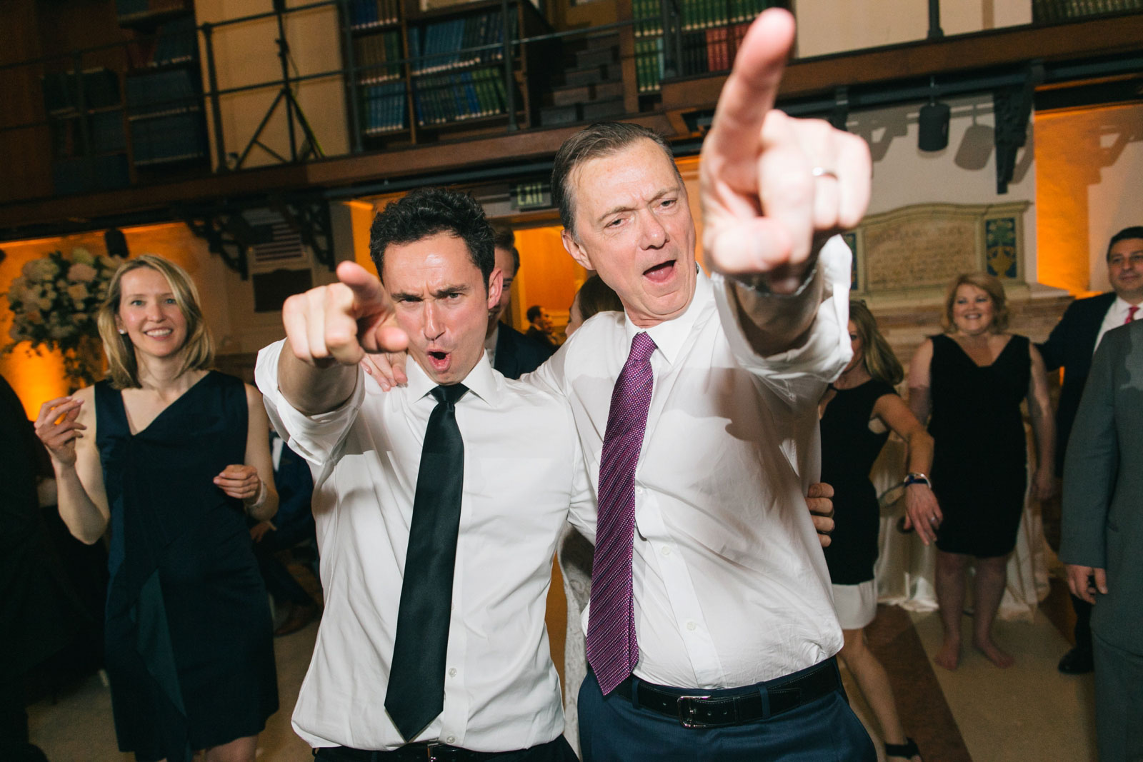 groom dancing with his dad on the dance floor at wedding reception at Boston Public Library