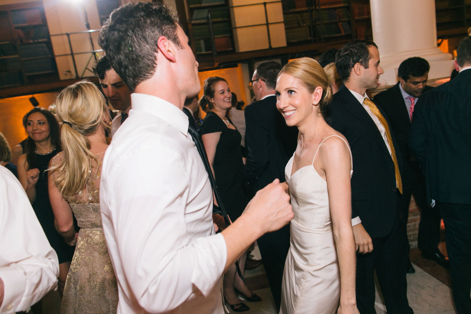 bride smiling and dancing with groom at elegant wedding reception at Boston Public Library
