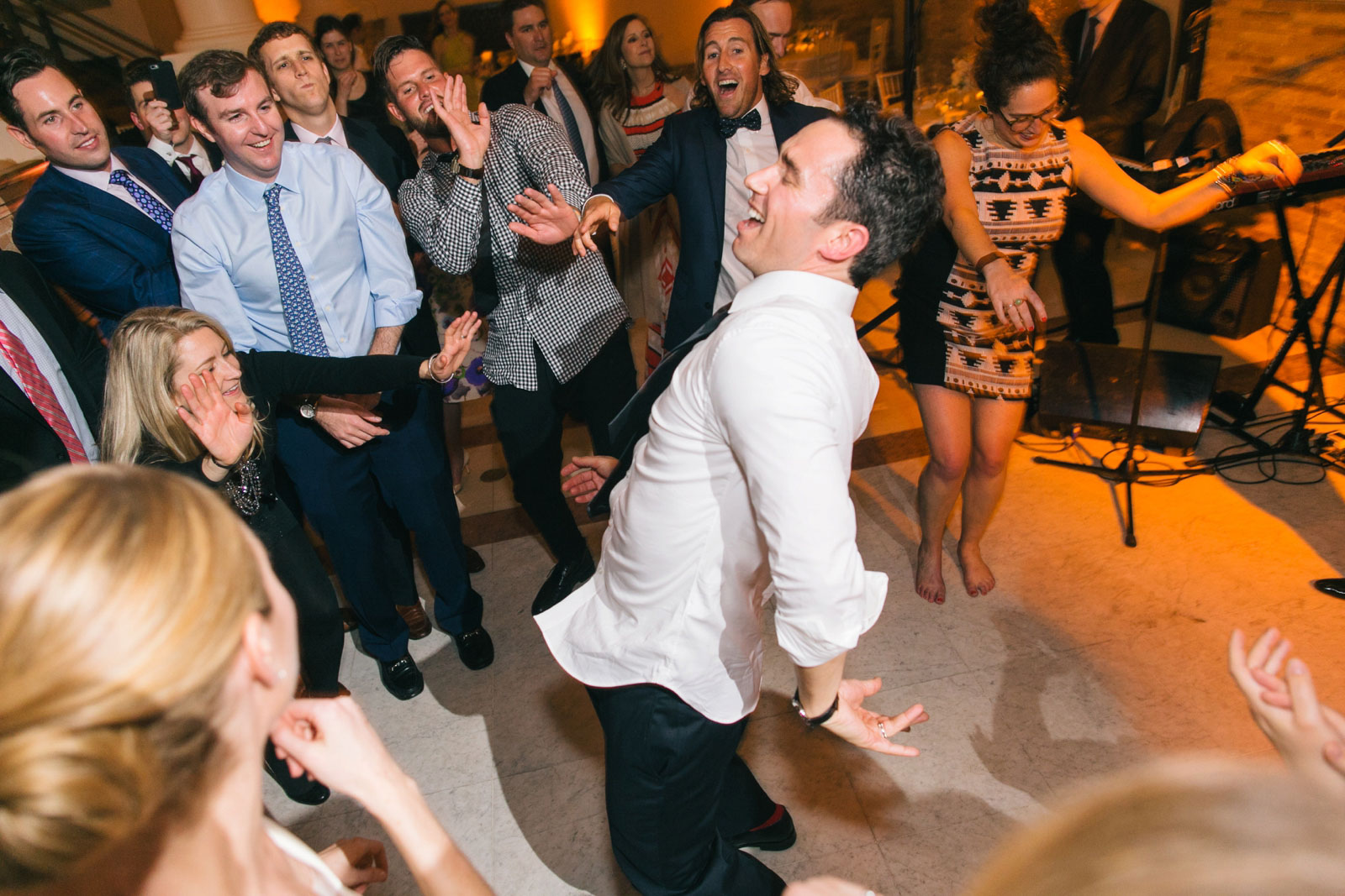 Groom dancing like crazy on dance floor at Boston Public Library wedding reception