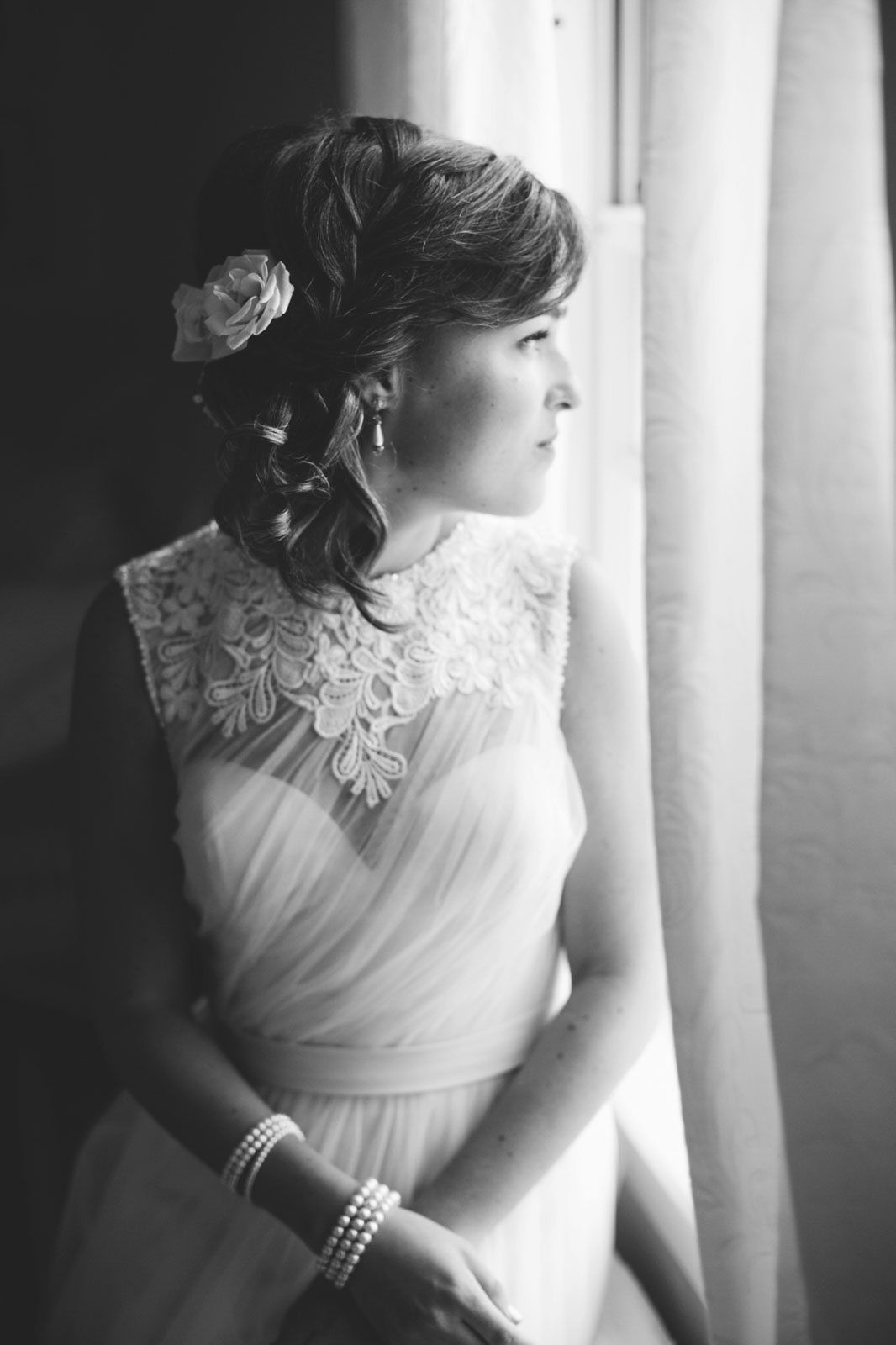 Beautiful portrait of bride looking out the window, natural window light, black and white