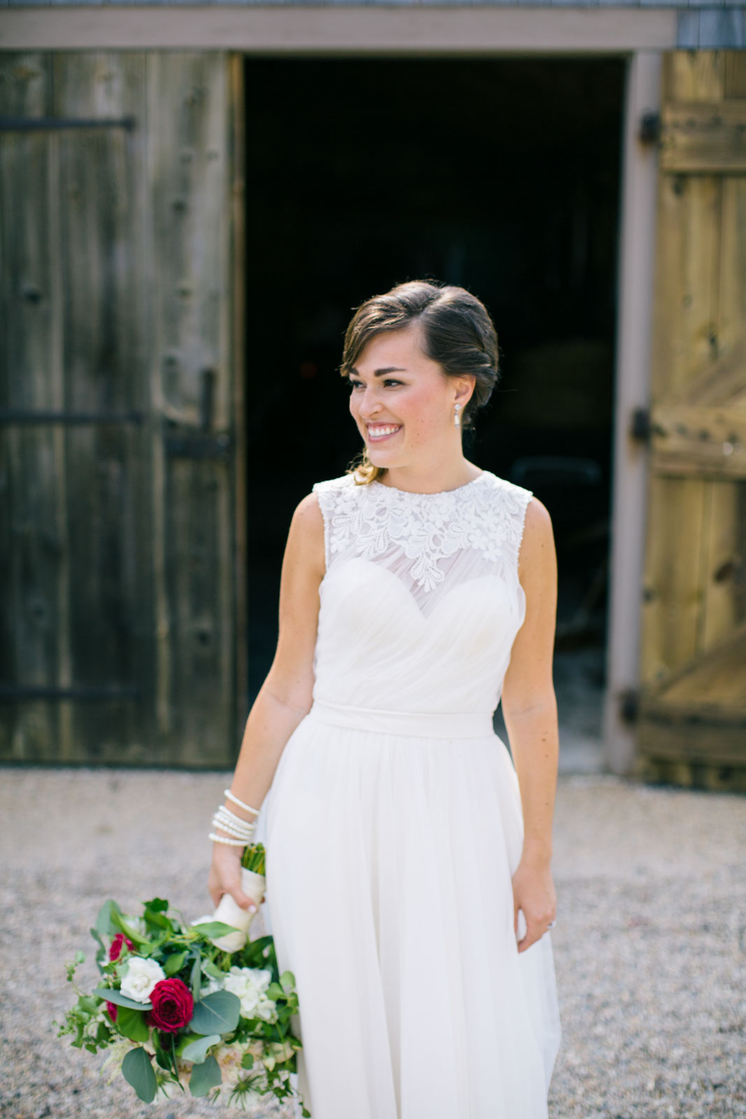 portraits of bride walking in front of barn, beautiful natural light