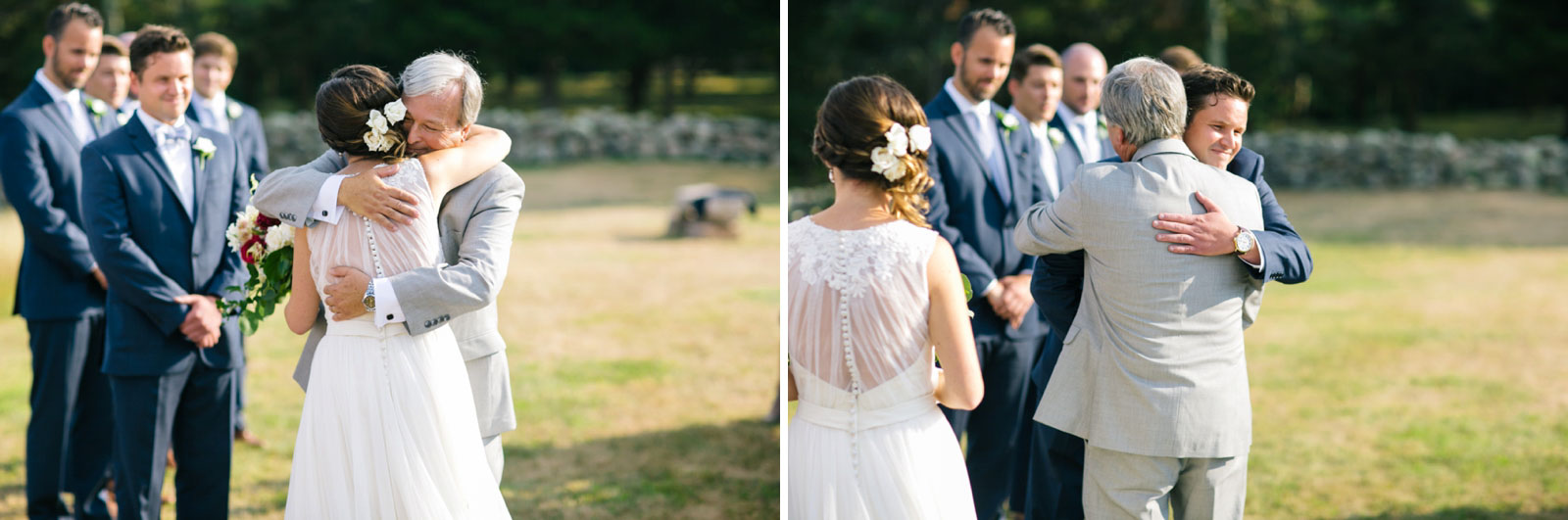 Father of the bride giving away his daughter, and embracing bride and groom, summer wedding on cape