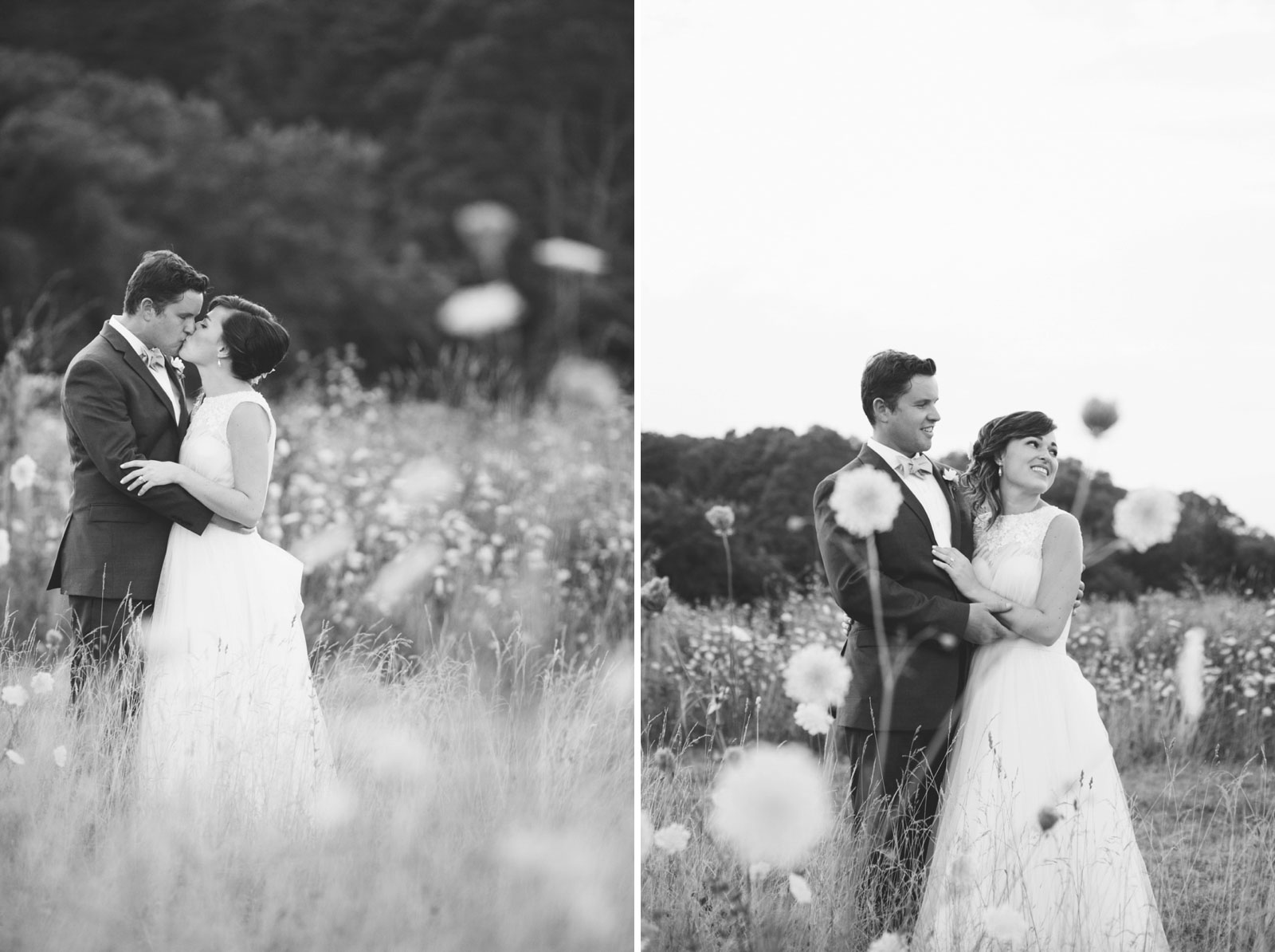 romantic black and white bride and groom in a field of wildflowers kissing and holding each other.