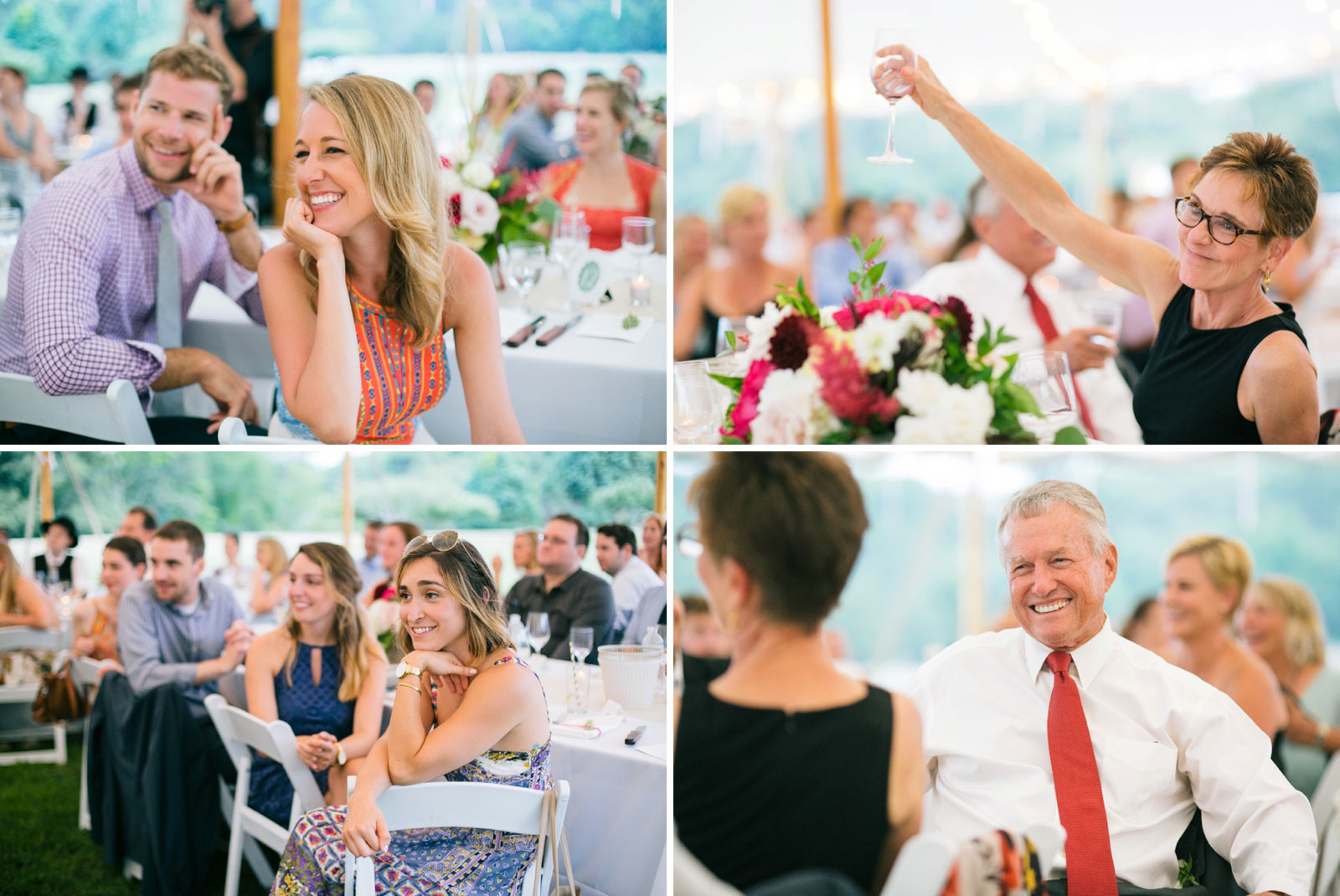 Guest smiling and reactions to speeches at summer afternoon tented wedding with soft natural light