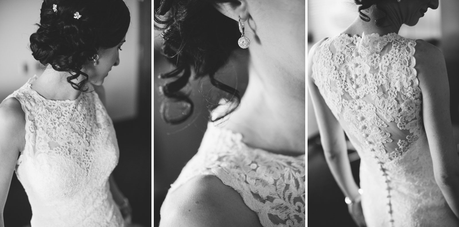black and white details of bride's round crystal earrings and button up wedding dress with lace back