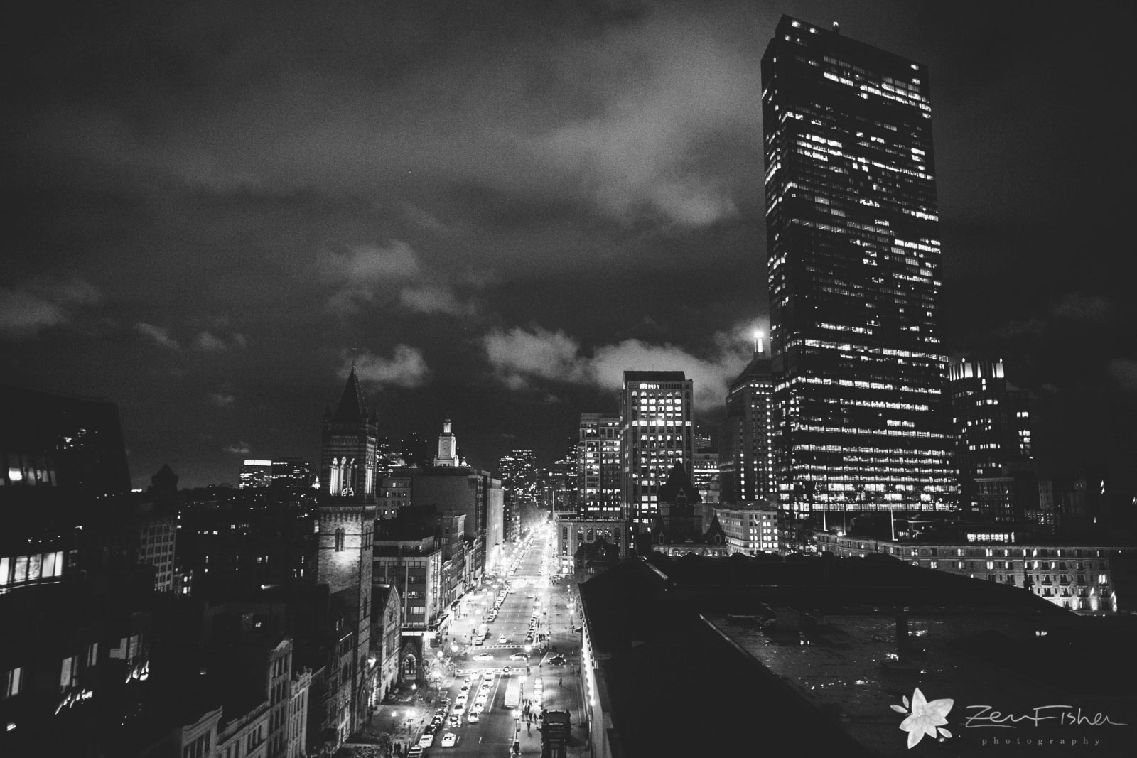 The striking view from the Lenox Hotel of the Boston skyline at night, in black and white.