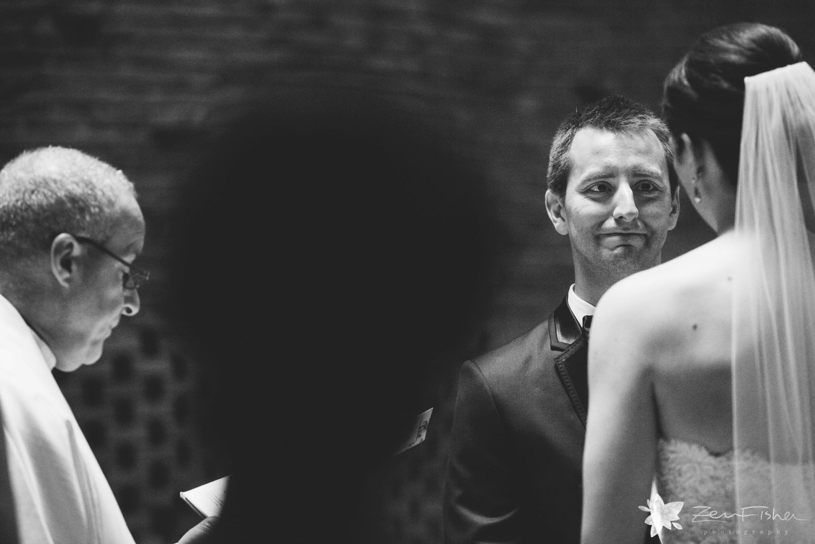 Groom holds back tears as he looks at his beautiful bride during the wedding ceremony.