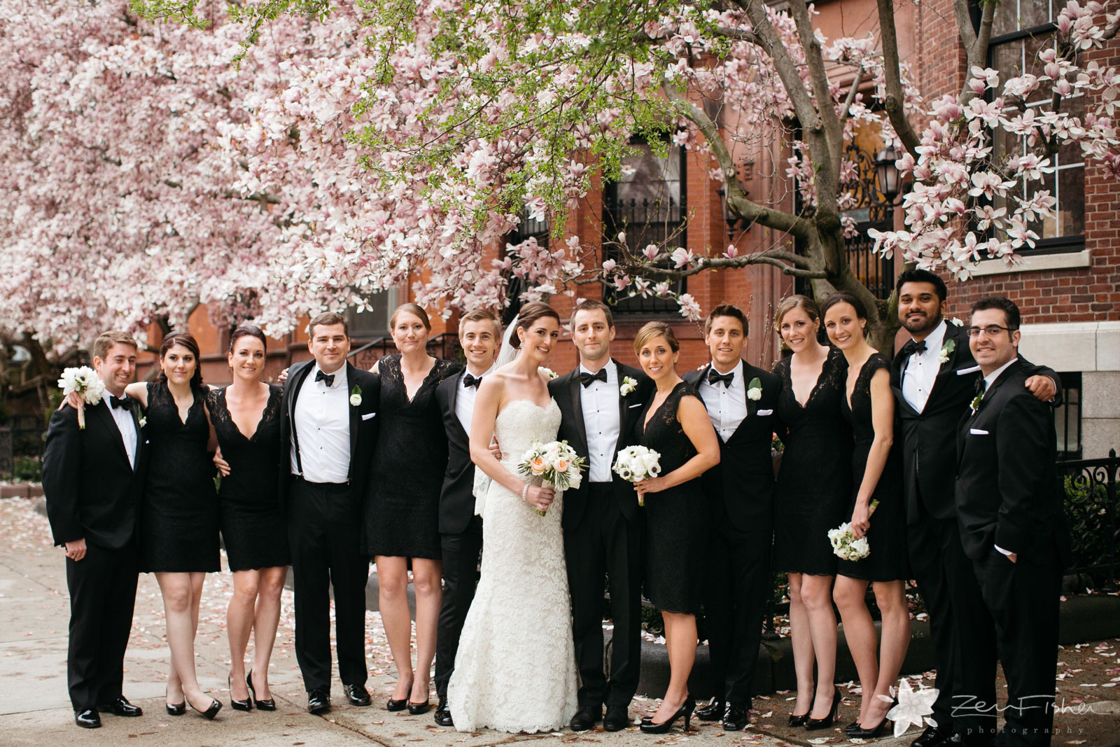 Formal bridal party portrait in front of Boston brownstones, blooming magnolia trees in springtime.