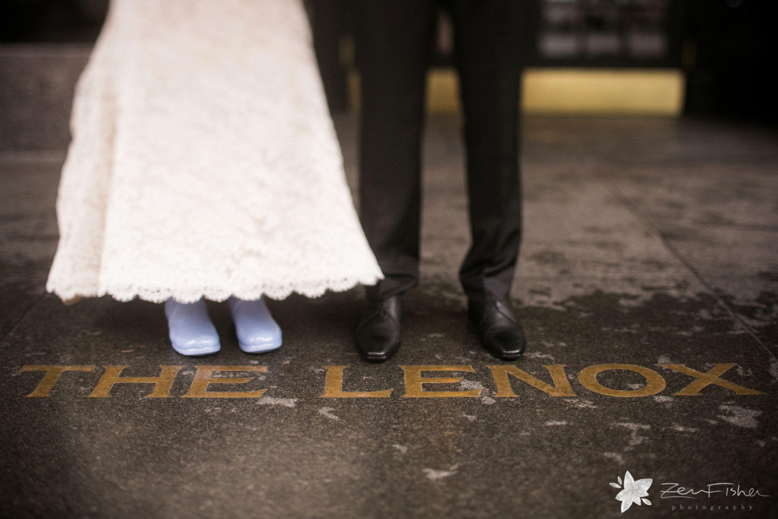 Detail of bride and groom's shoes while standing outside Lenox Hotel Boston.