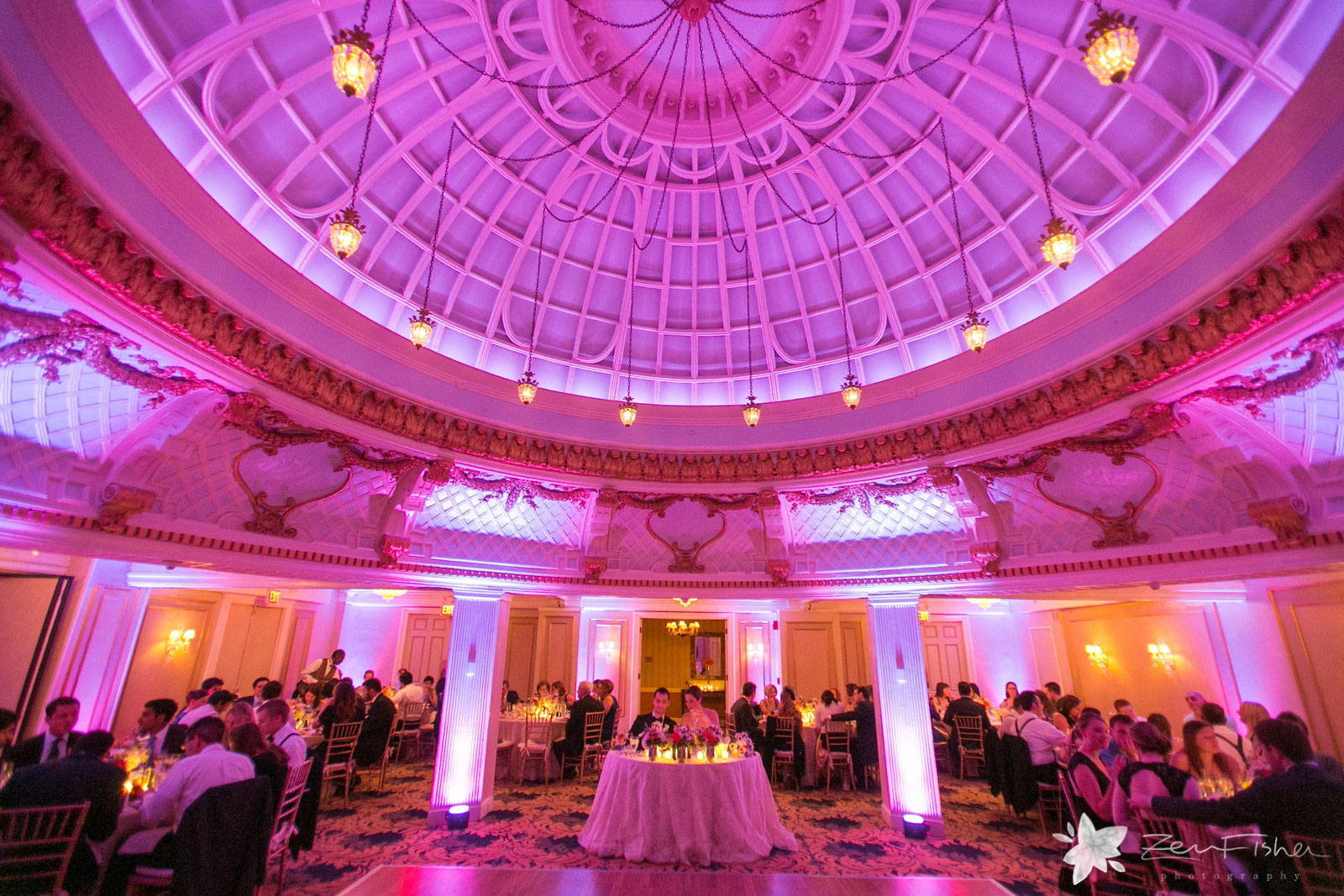 Epic wide shot of pink lights and elegant decor at the reception hall at the Lenox hotel.