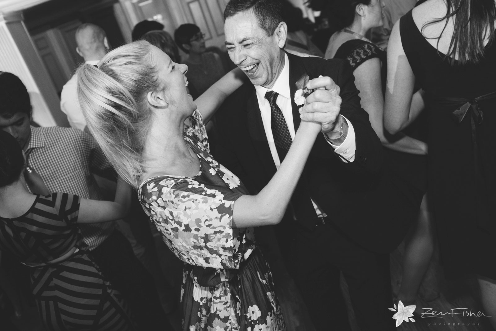 Guests having fun dancing on the dance floor, in black and white.