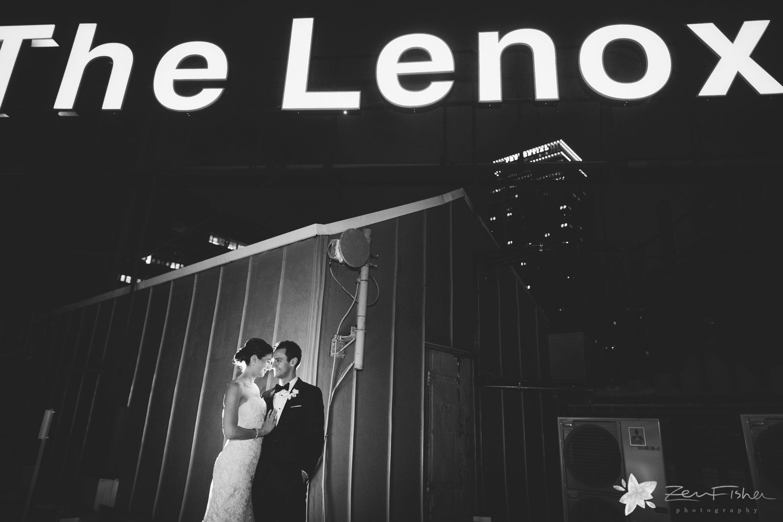 Bride and groom on the roof of the Lenox Hotel sharing a quiet moment together at end of the night.
