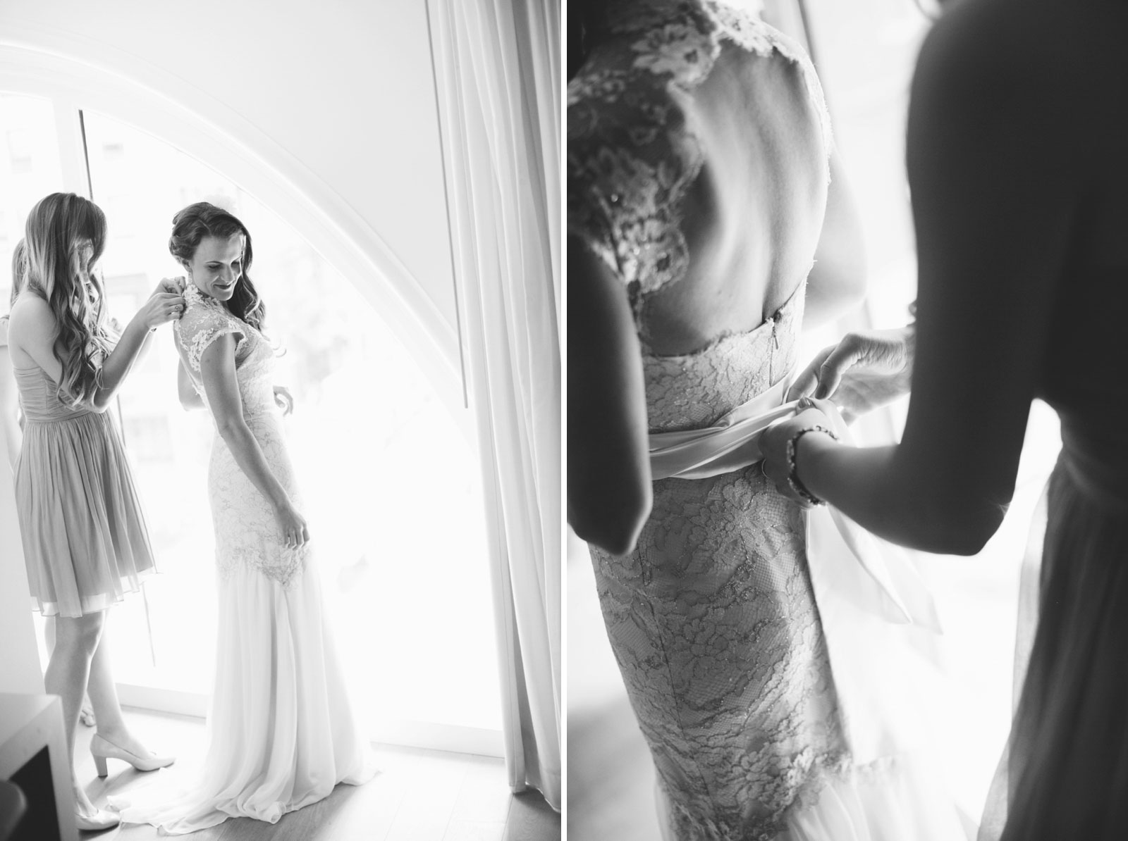 black and white shots of bridesmaid helping bride into backless lace dress in front of window