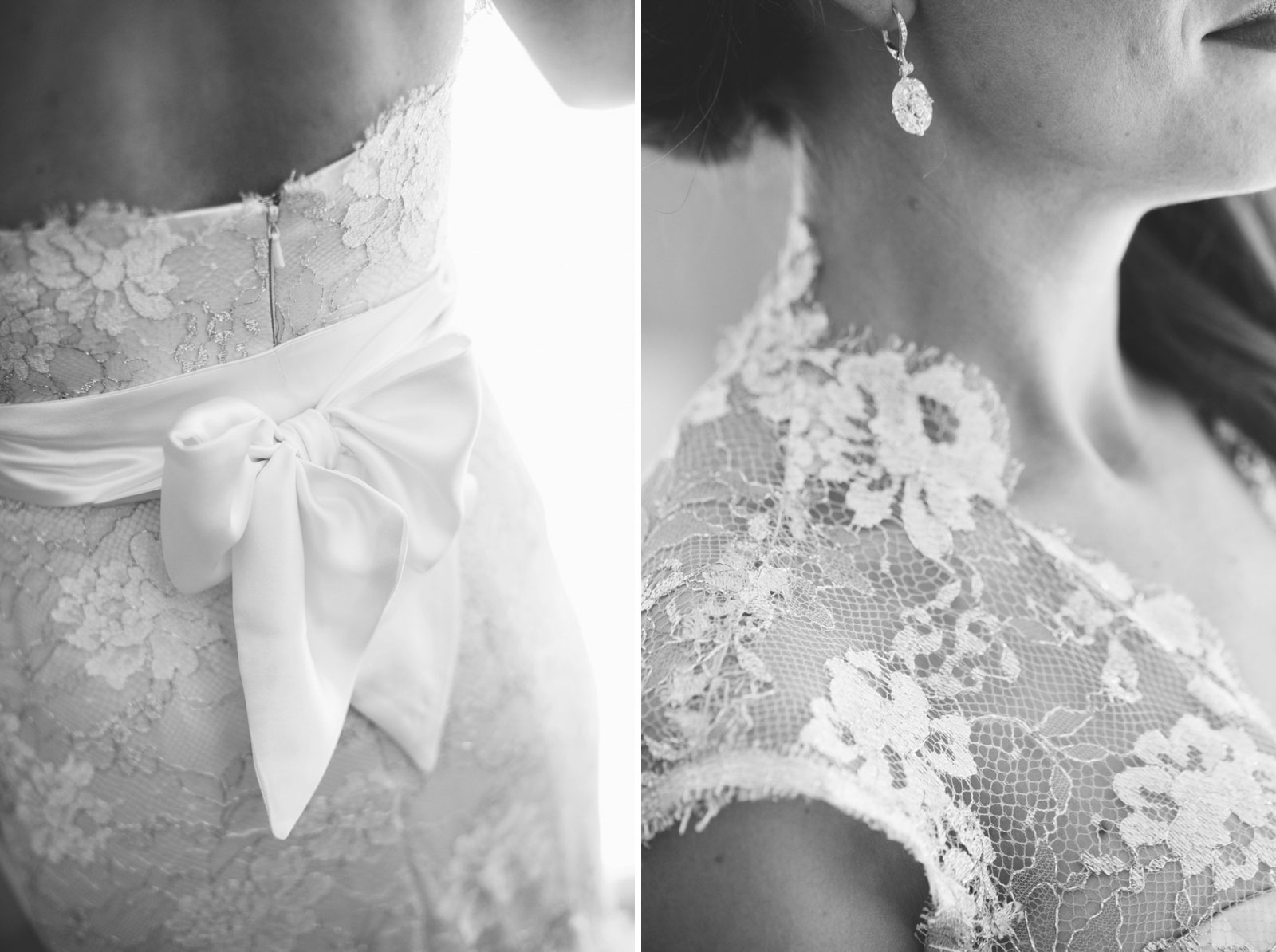 black and white details of bride's lace dress with satin belt and and diamond earrings