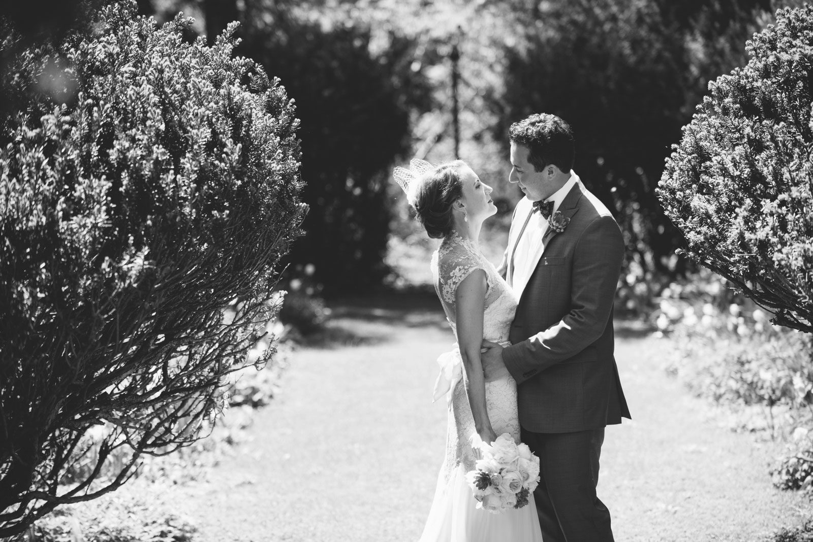 romantic black and white portrait of bride and groom in wildlife sanctuary at Mass Aububon