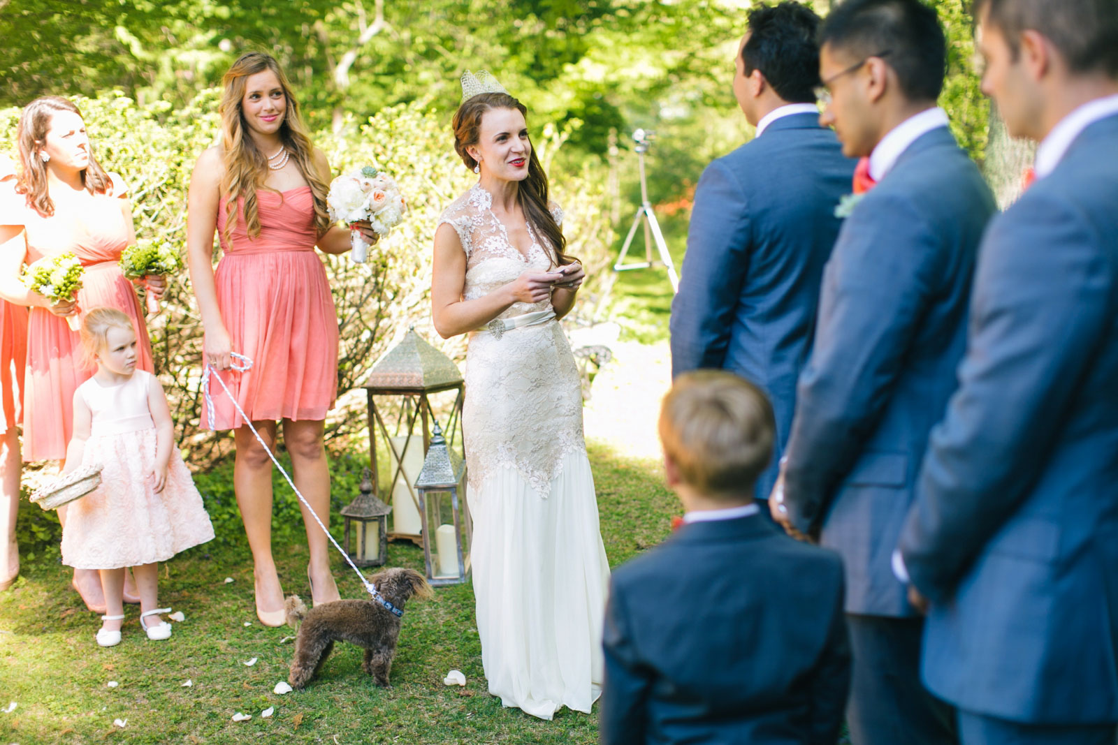 bride saying vows during garden wedding ceremony with dog at Mass Audubon wedding