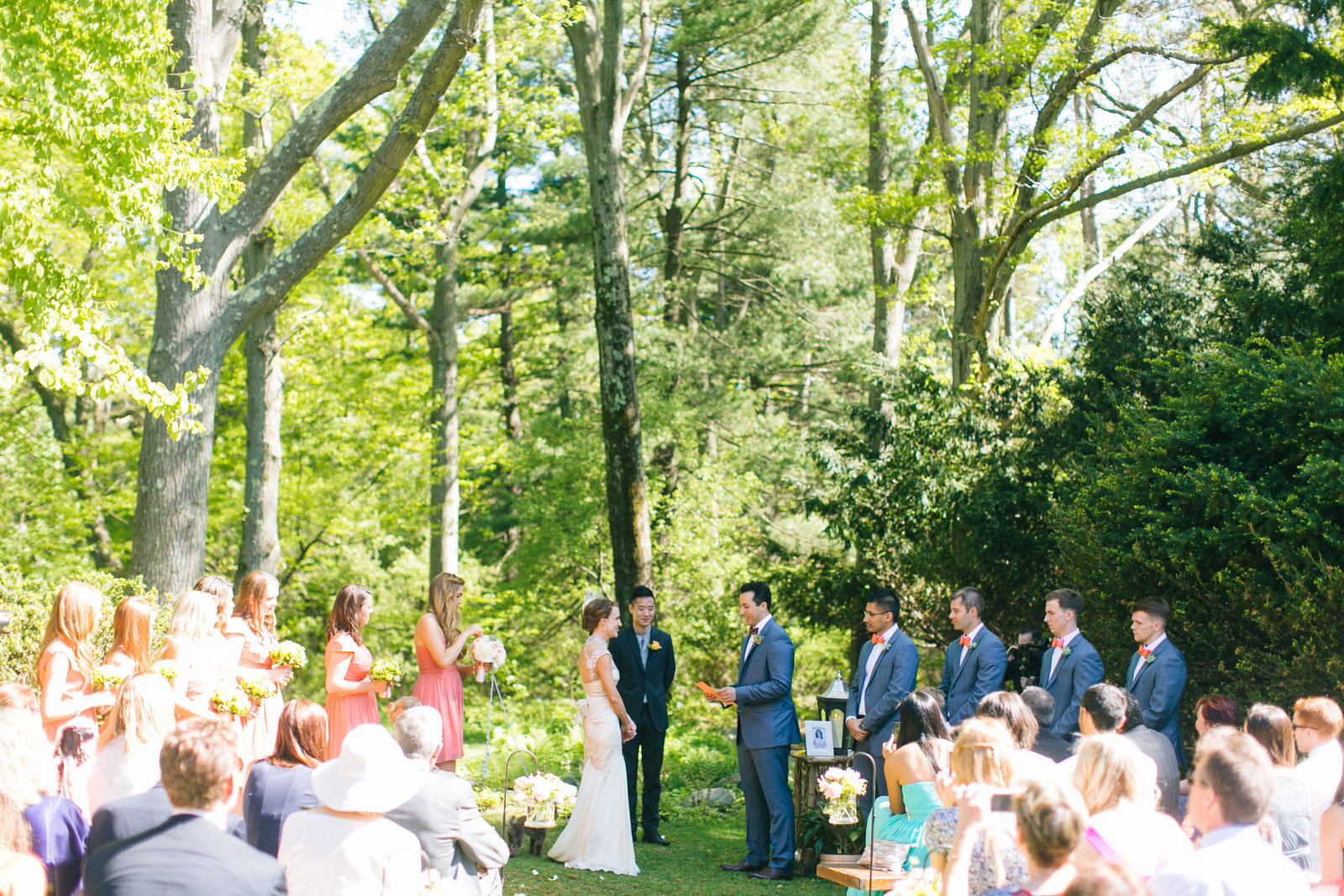 groom saying his vows at summer wedding ceremony in the woods in New England