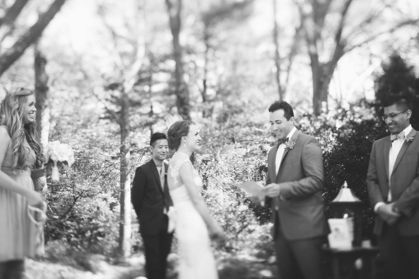 black and white shot of groom saying his vows during sunny summer wedding ceremony in Boston