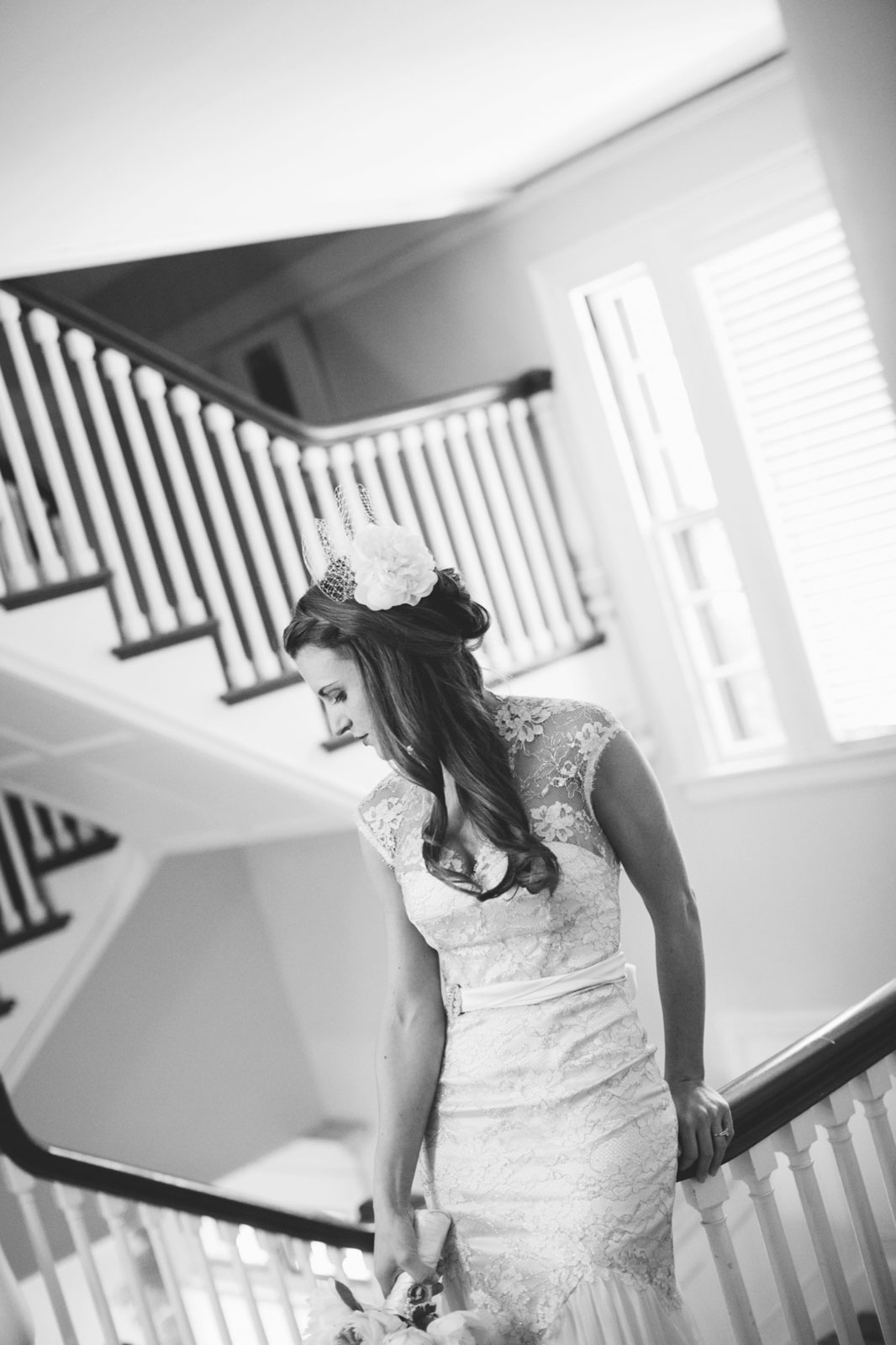 black and white portrait of bride in stairway at Mass Audubon's Habitat Education Center