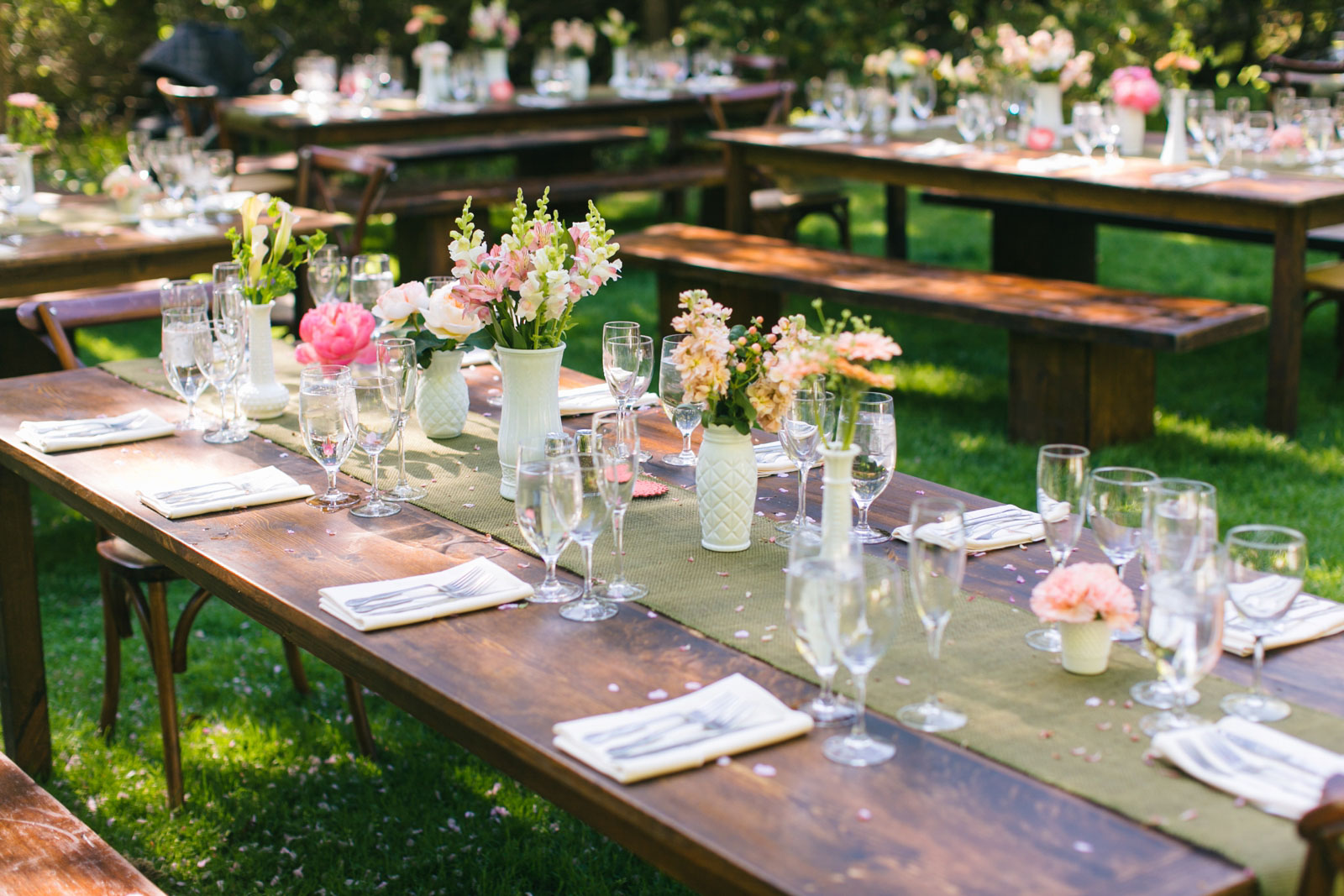 rustic tablescape decor with dark wood farm tables and benches