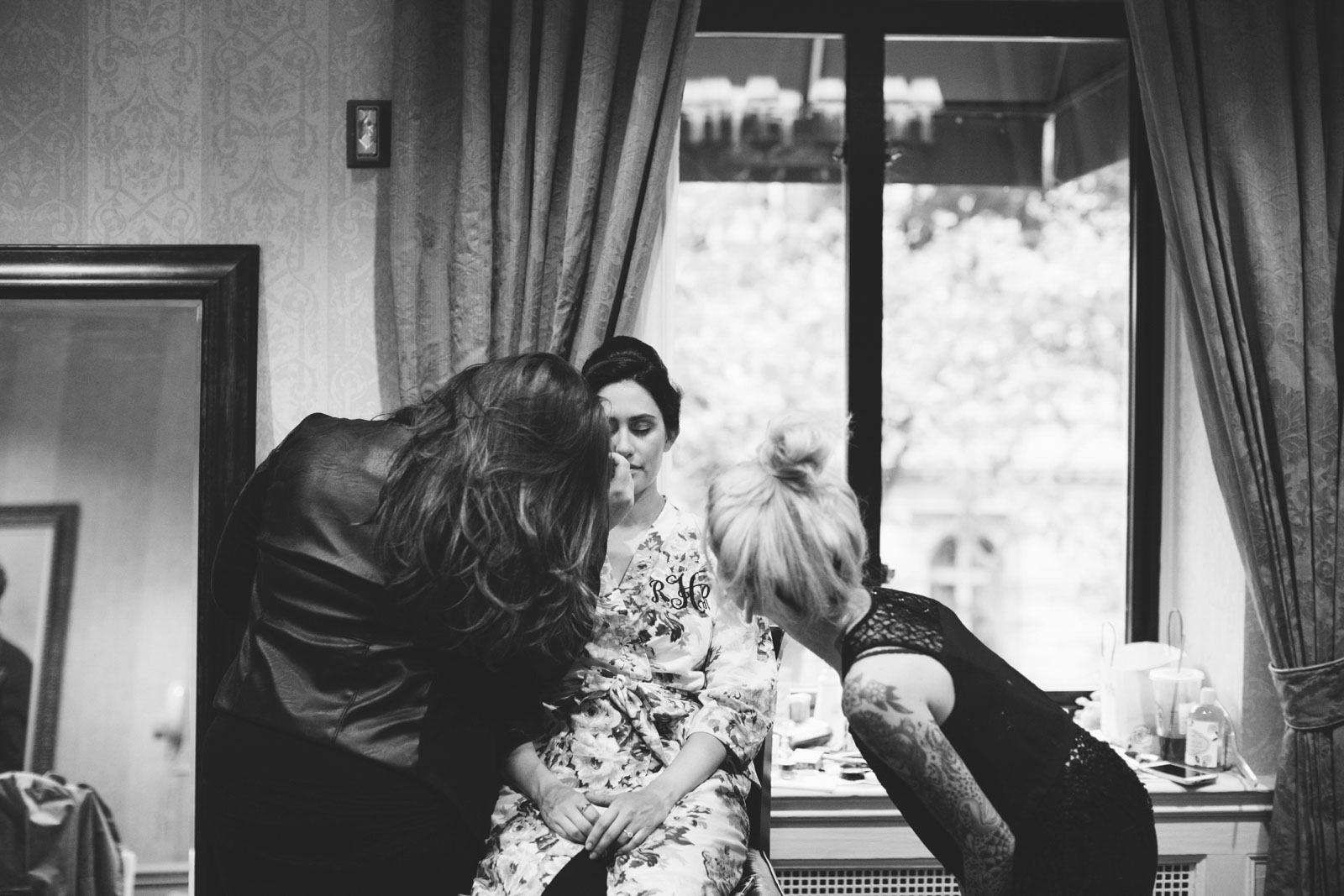 black and white shot of bride getting her hair and make up done in boston hotel bridal suite