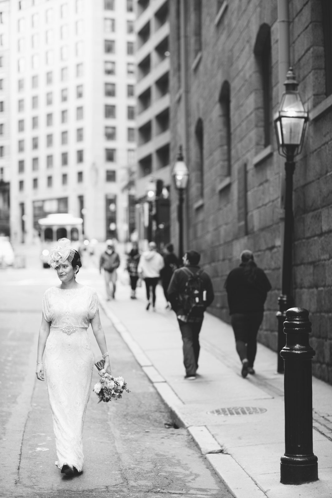 black and white vintage bride walking down the streets of Boston with old street lamps