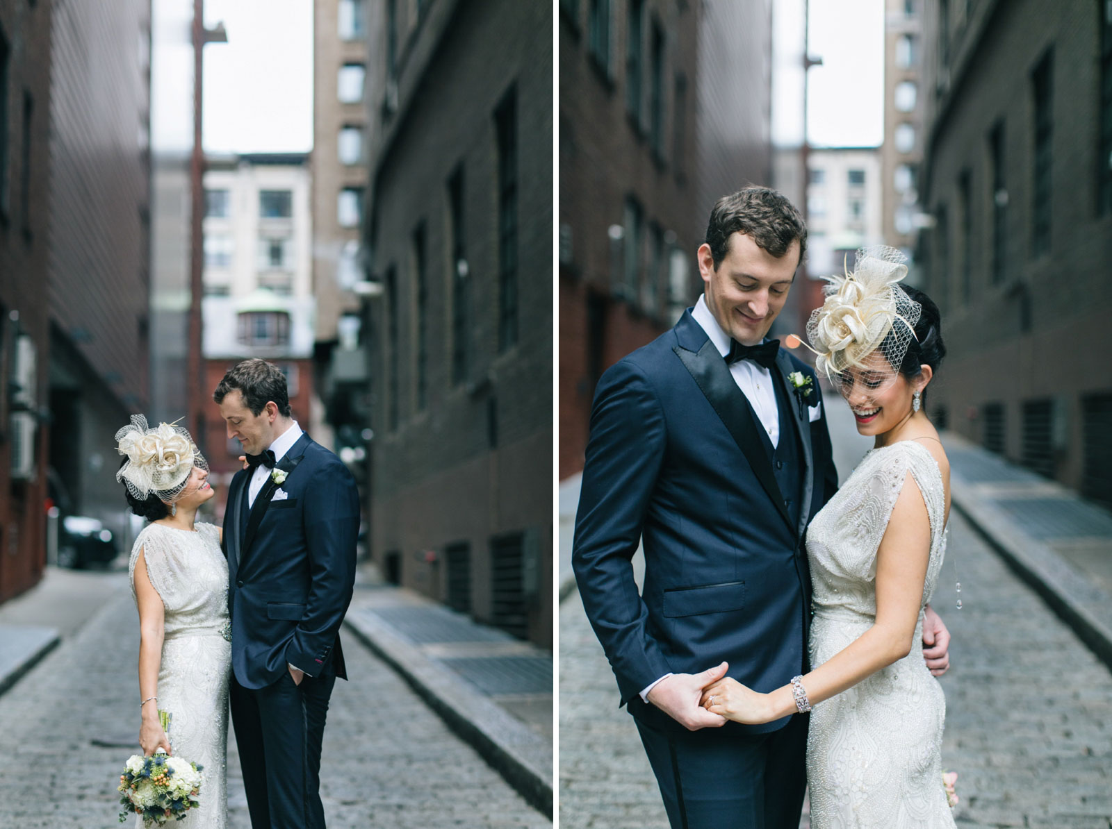 Candid portraits of bride and groom standing in alleyway, black tie navy suit with silk lapel