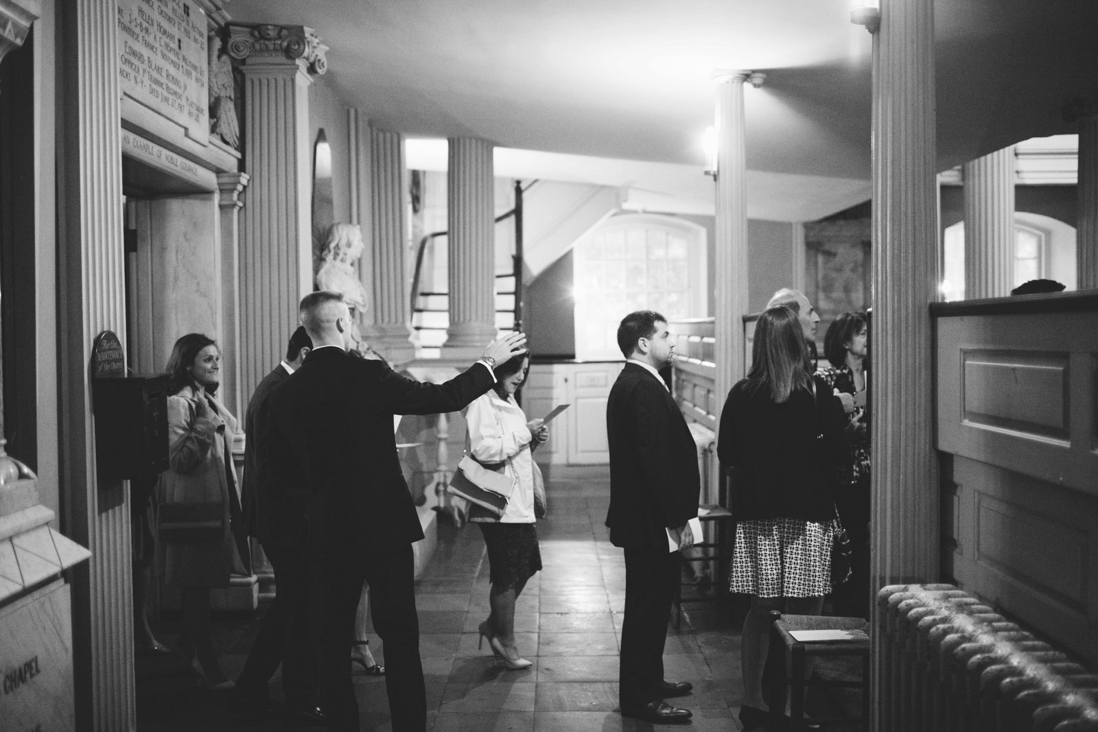 black and white shot of guests arriving at King's chapel, and ushers helping guests to their seats.