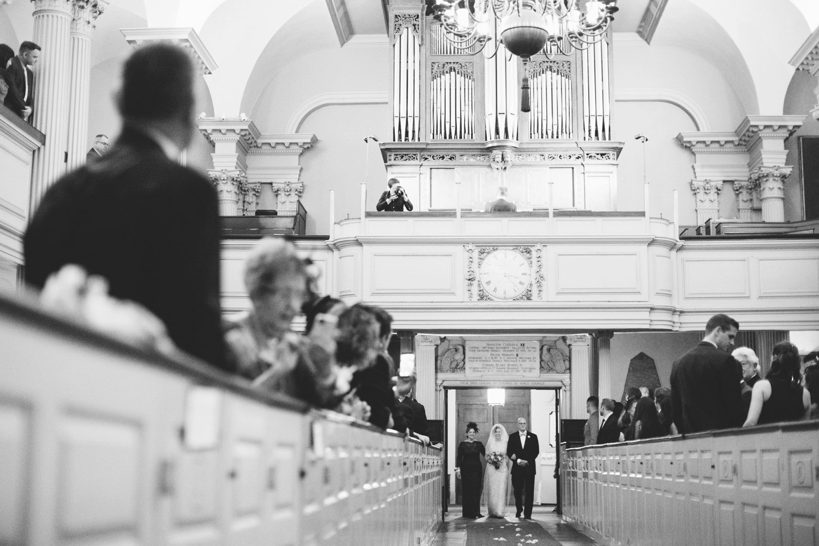 Epic Black and white shot of bride walking down the aisle with her parents at 1920s King's Chapel