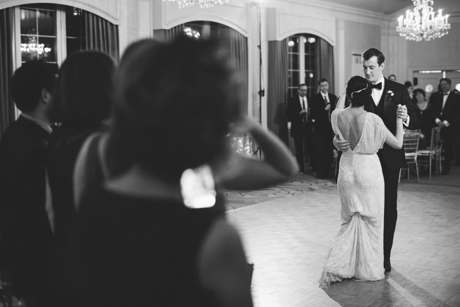 bride and groom share their first dance during 20s-themed wedding reception at Omni Parker House