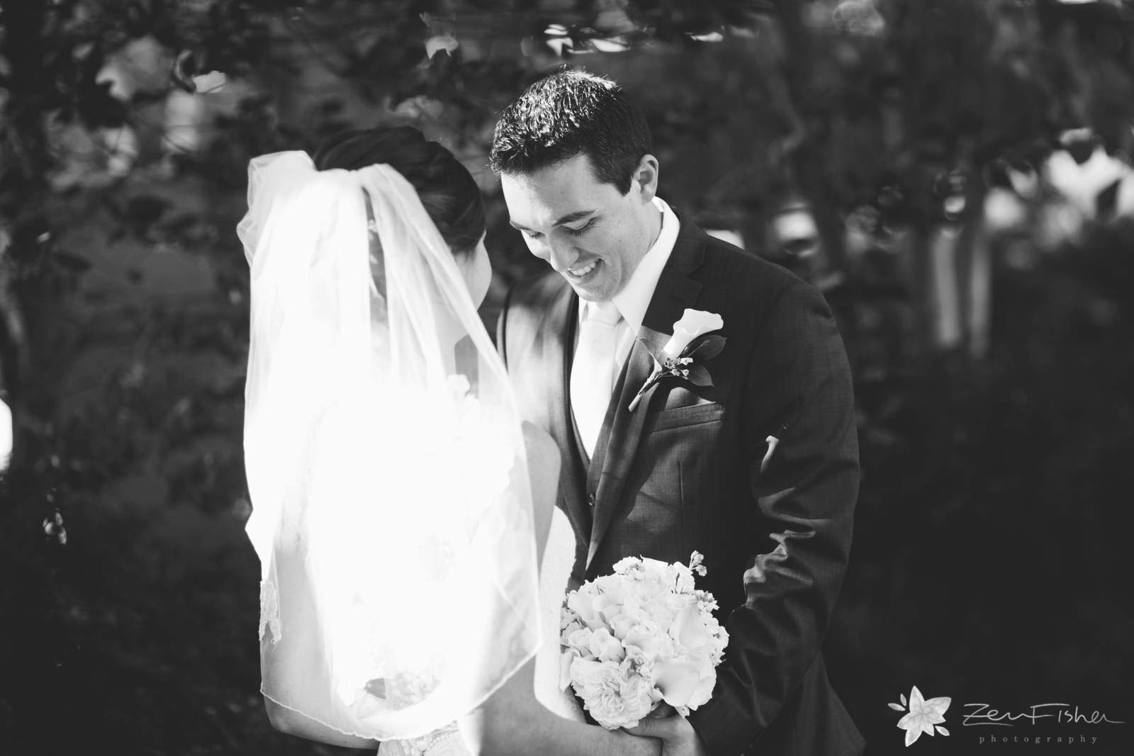 Groom sees bride for the first time, groom looking at bride during first look, black and white