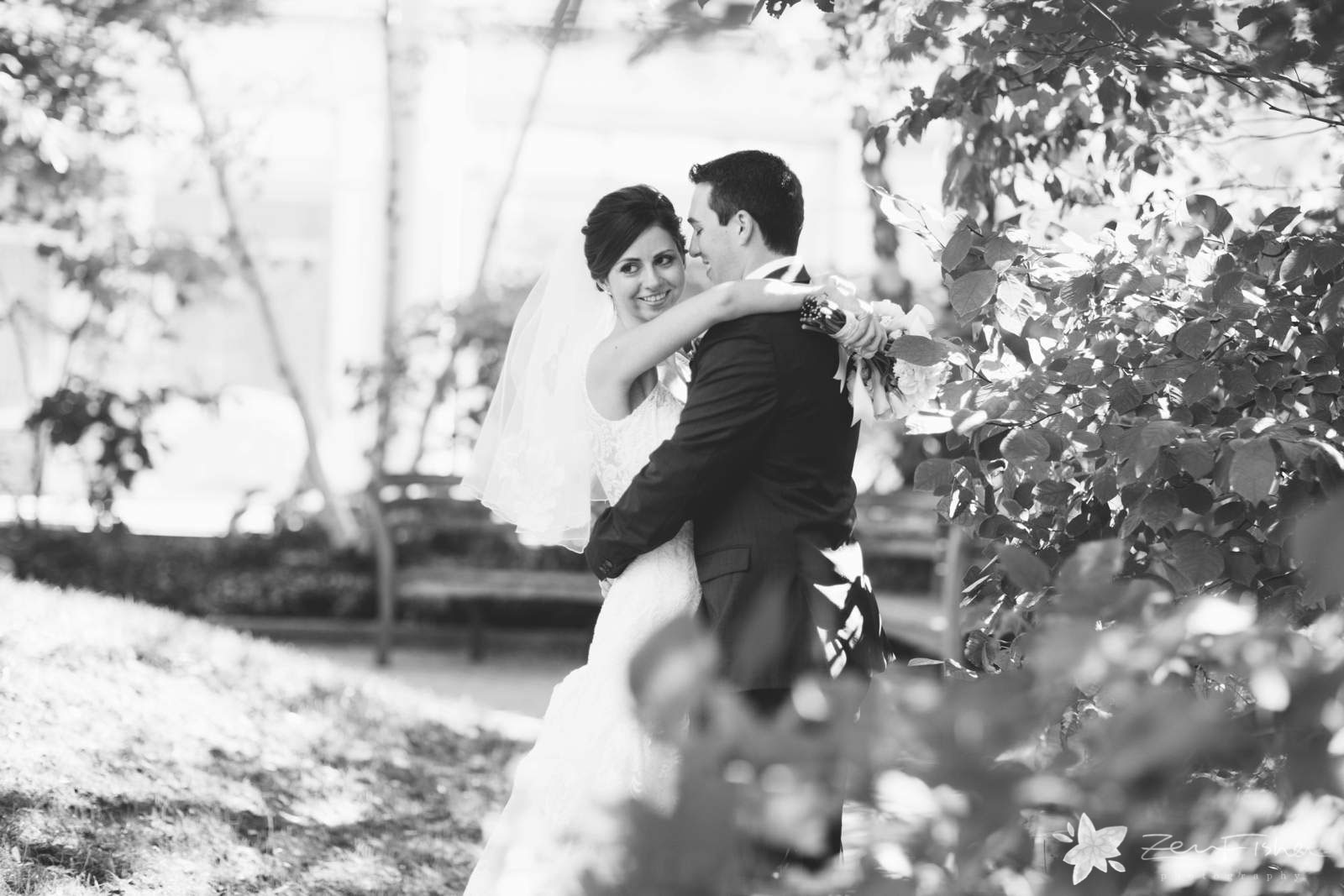 Black and white bride and groom portrait in garden during first look.