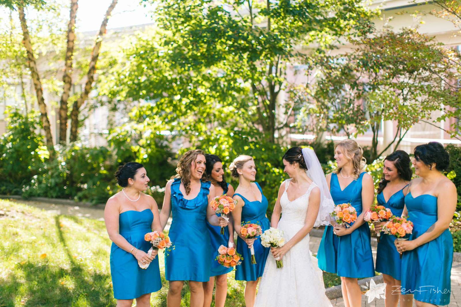 Casual bridal party portraits in garden on a sunny day in the fall, beautiful natural light.