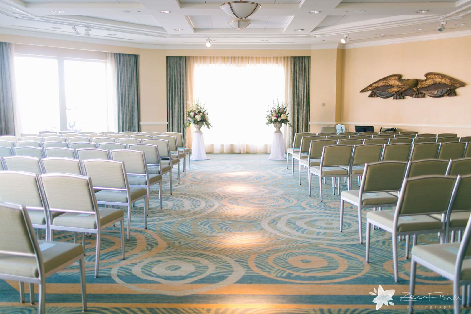 Simple modern ceremony room in Seaport hotel in Boston, large windows with natural light