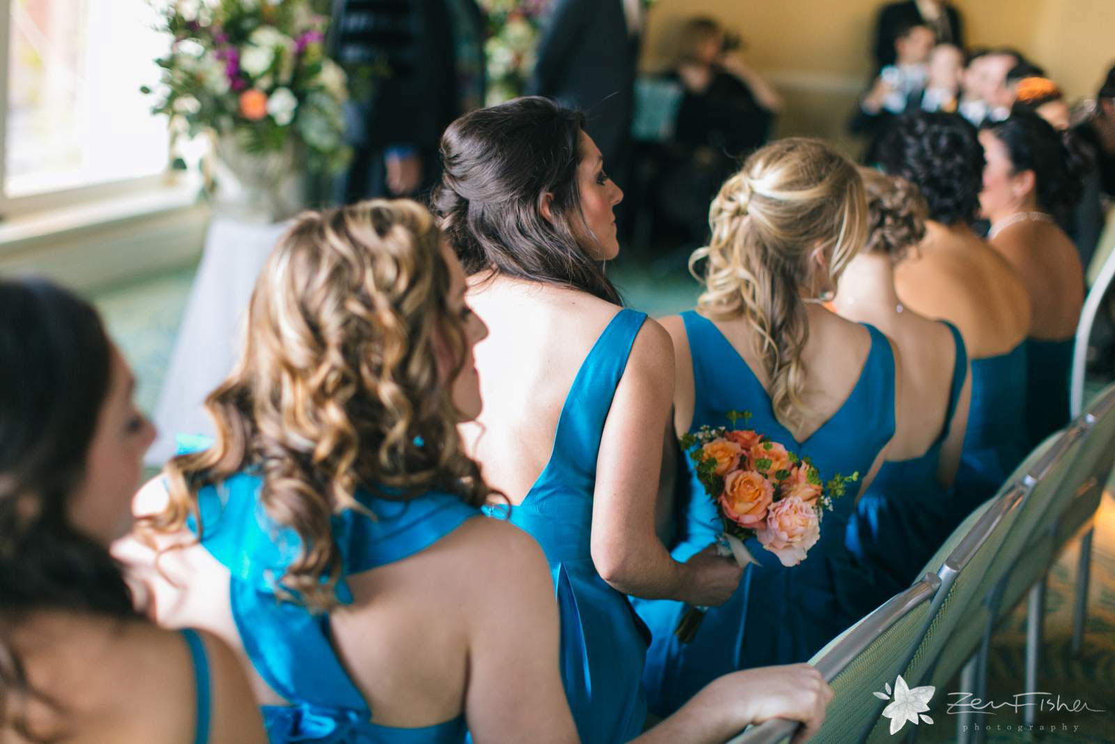 Bridesmaids turn around in their chairs in anticipation for bride to come down the aisle.